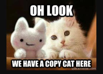 "Meme with a white cat and a stuffed animal cat that says ""Oh look, we have a copy cat here"""