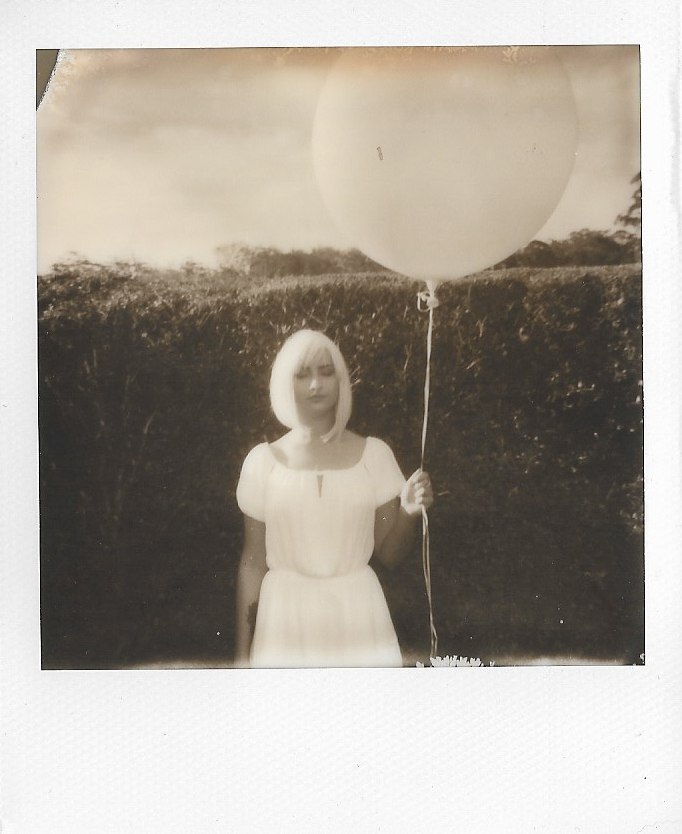 Polaroid outtake with Betty Lou