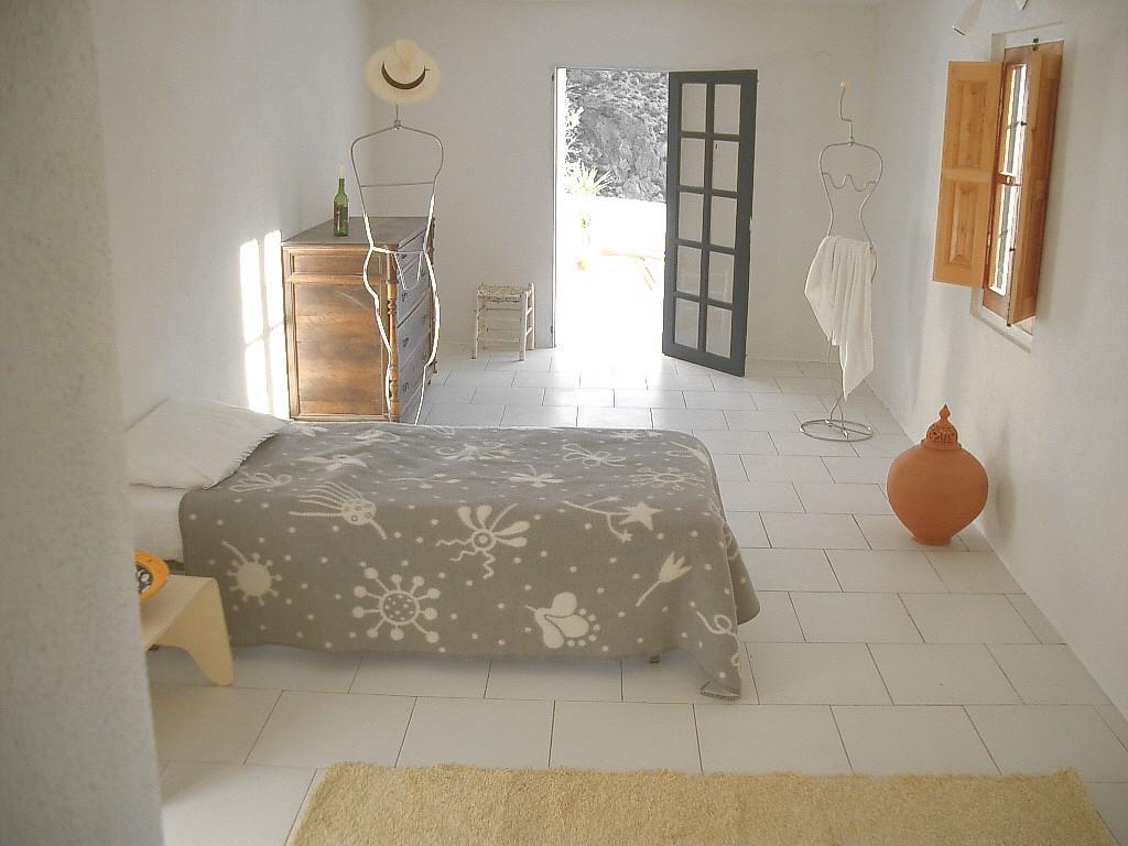 The White Balcony Bedroom