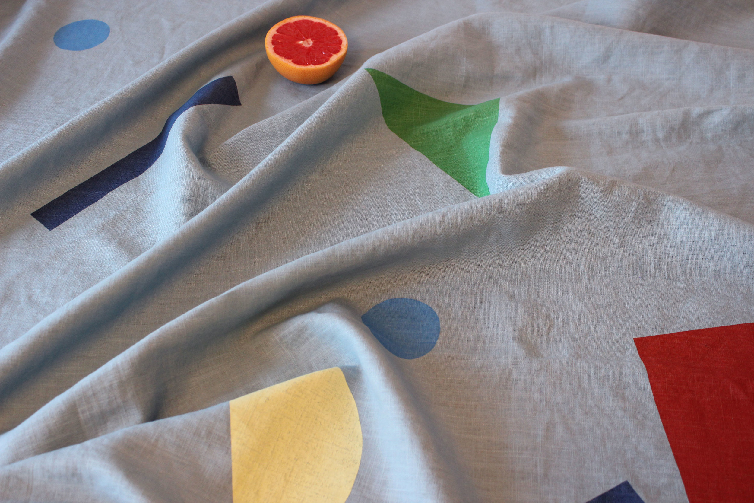 Linen throw screen printed by hand