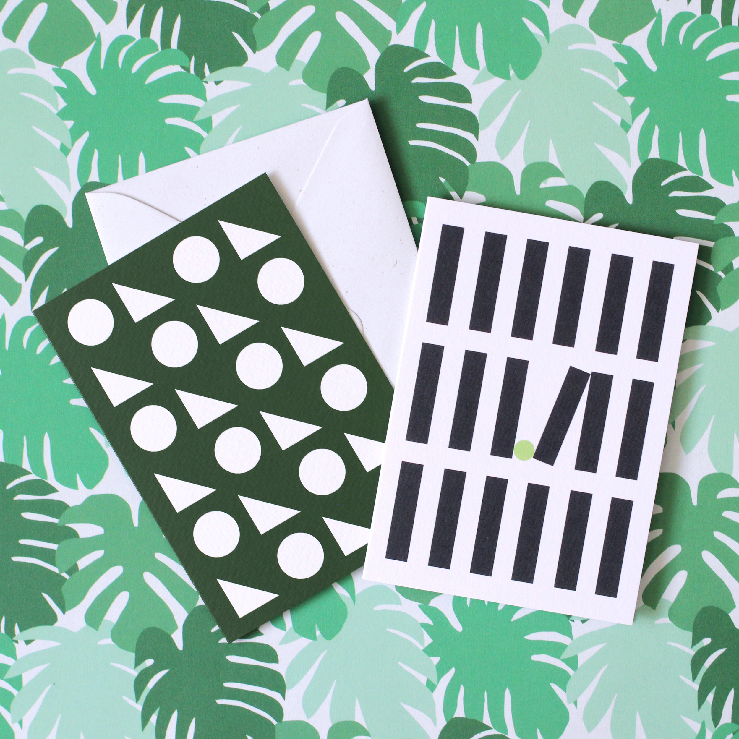 From left to right: 'Jungle wrapping paper, 'Toybox' greetings card, 'Tip off' greetings card