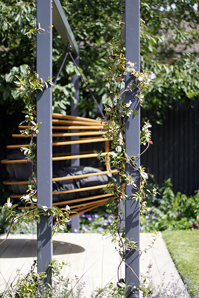 Raw chair hanging from bespoke pergola