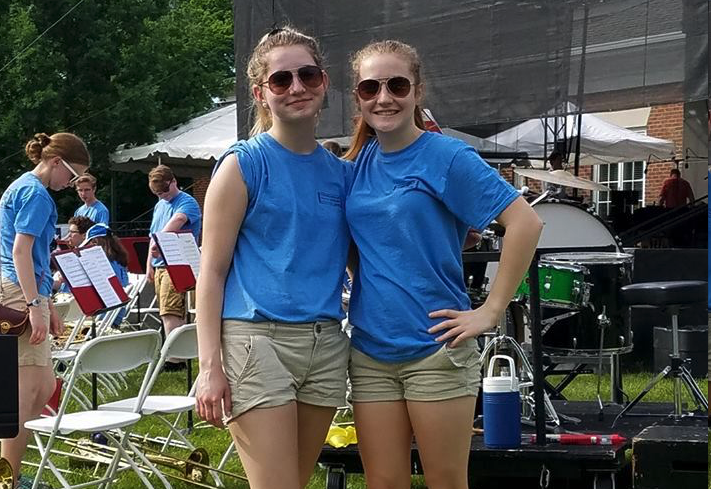 Some members of the trombone section pose for a candid photo before the Memorial Day Concert 2018!