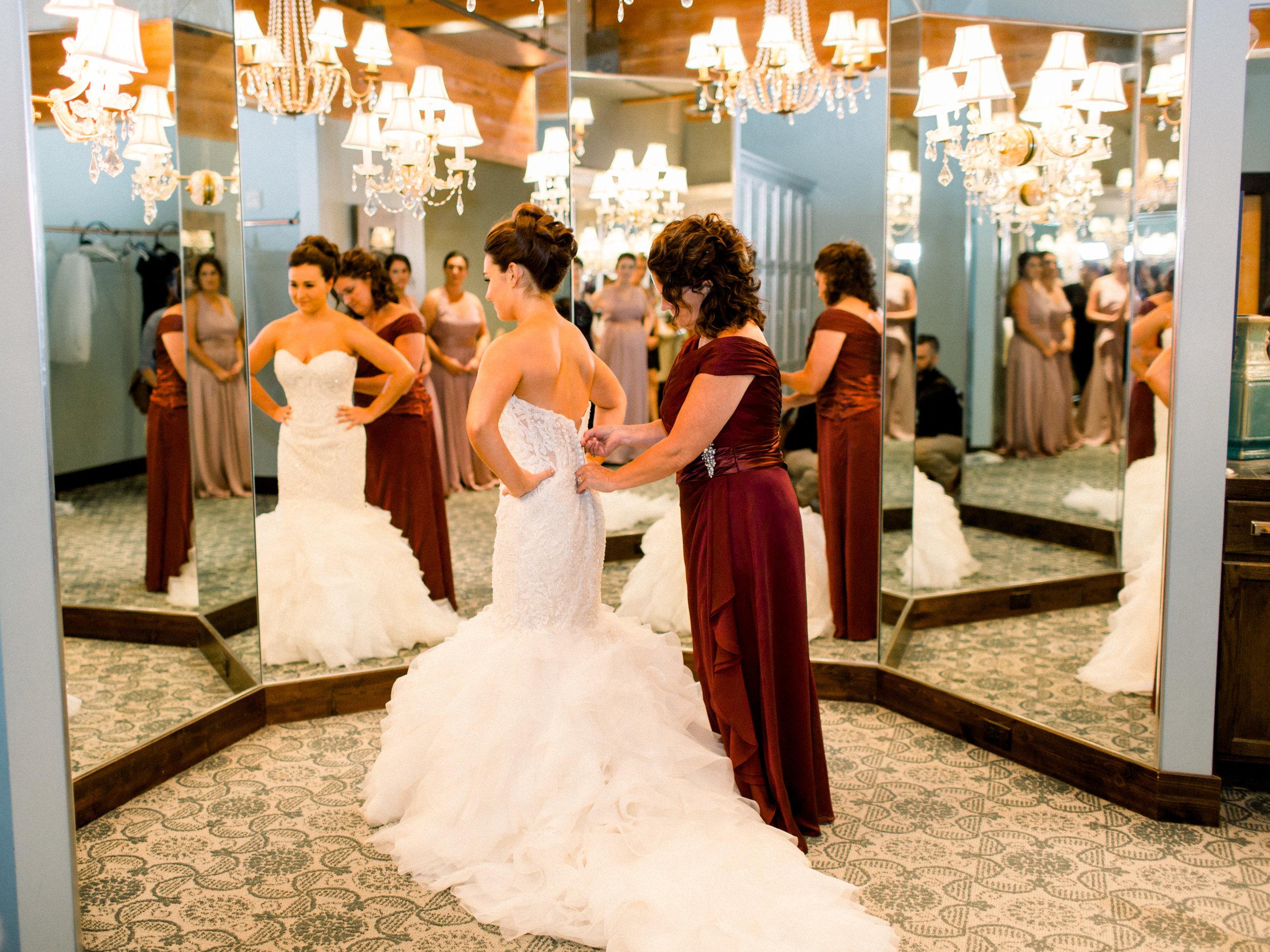 Bride Putting on Dress.jpg