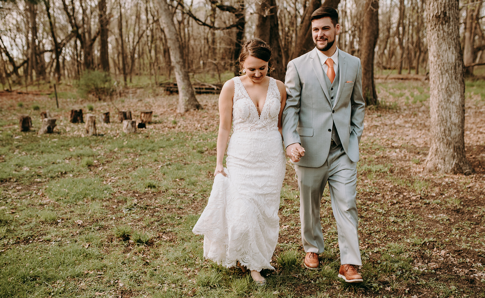 Bride & Groom Walking in the Woods.jpg