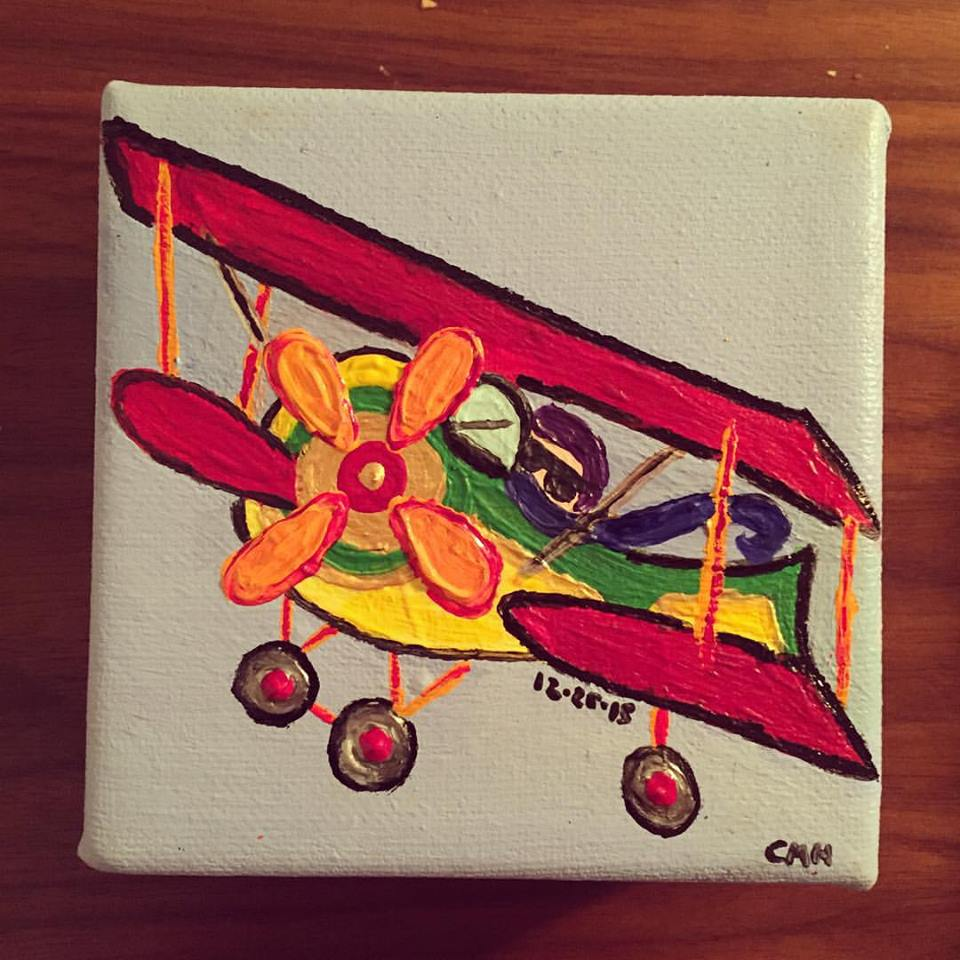Man in multicolored plane commission