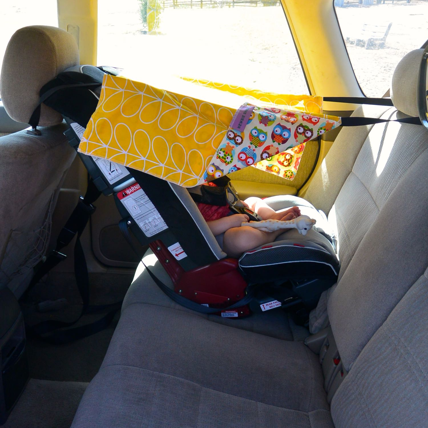 Step 8: Secure your baby in their car seat and enjoy Newbie Shade