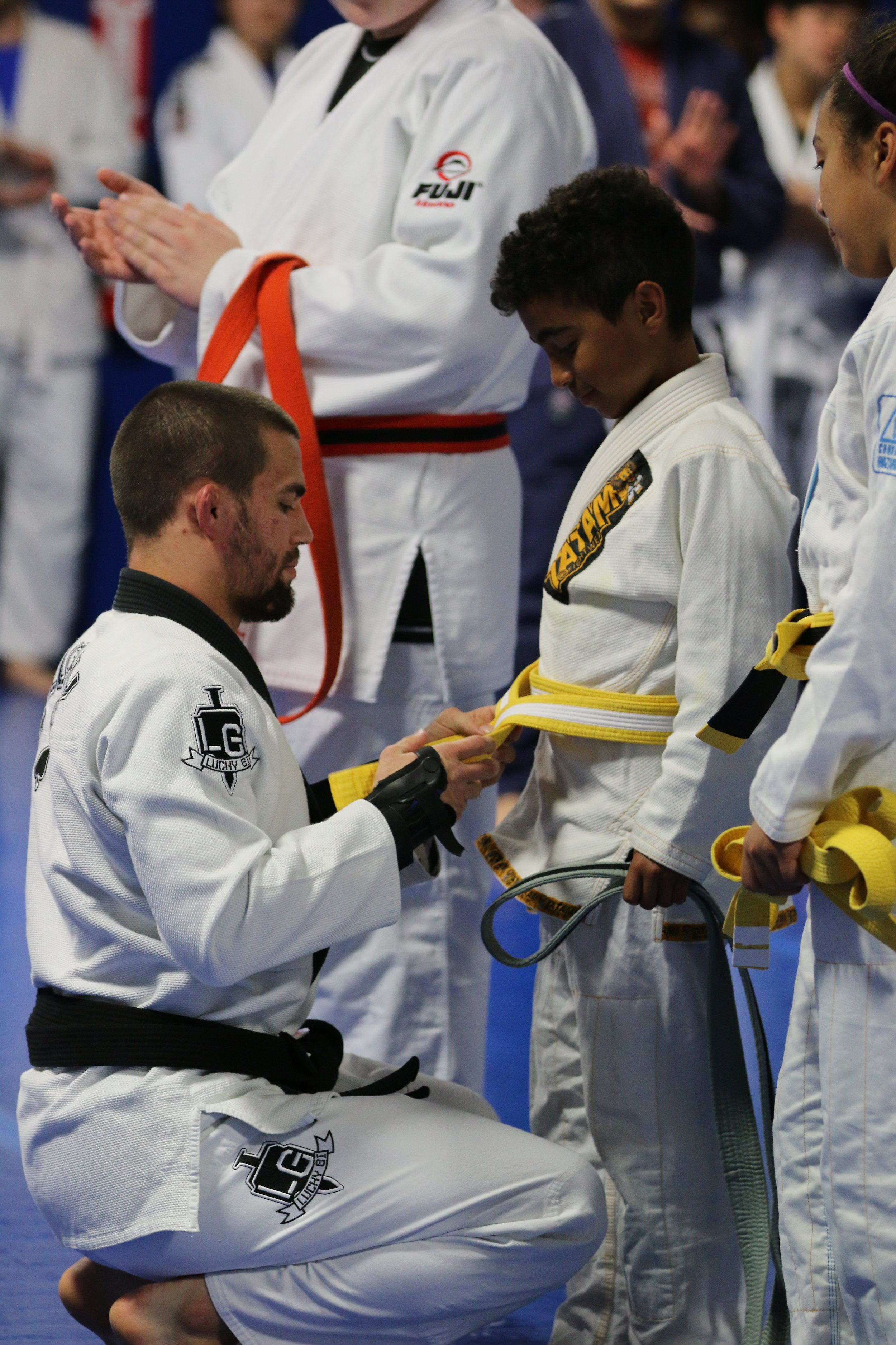 Garry Tonon promotes his young student from BJJ Grey belt to Yellow belt.