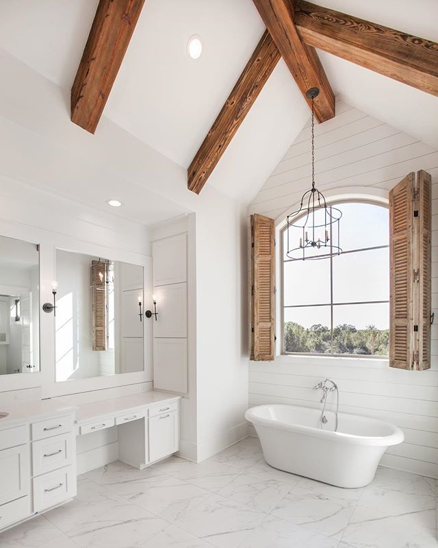 Vaulted beam ceilings make a statement in this custom owners suite! #porticohomes #bathroom #vaultedceiling #beams