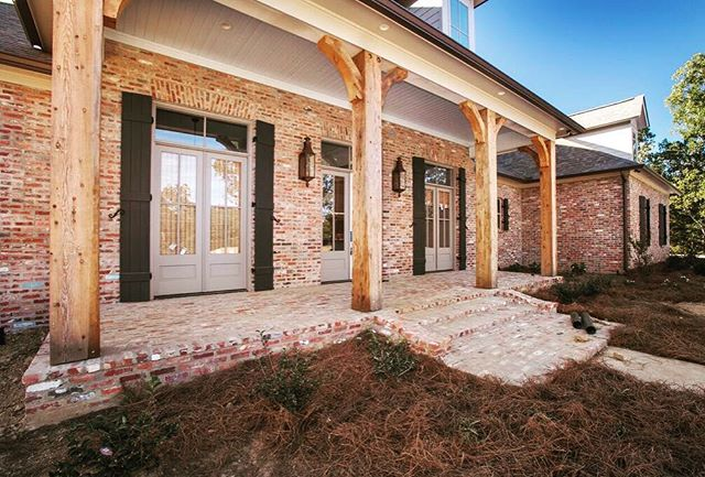 Reclaimed brick and timber post provide character that can only come from 100+ years of use. #porticohomes #farmhouse #homes #brick