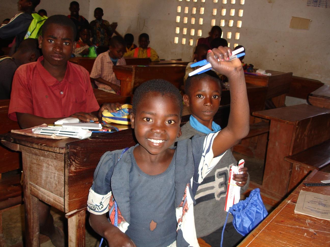 Malawian schoolgirl with donated backpack.jpg
