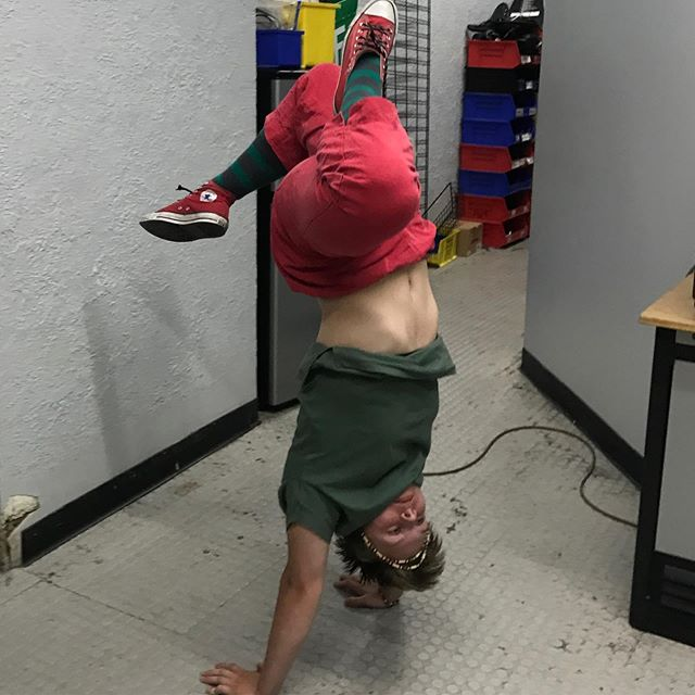 FYI this is what we do in the break room after a long day. And you? #bikeshop #bikeshoplife #handstand