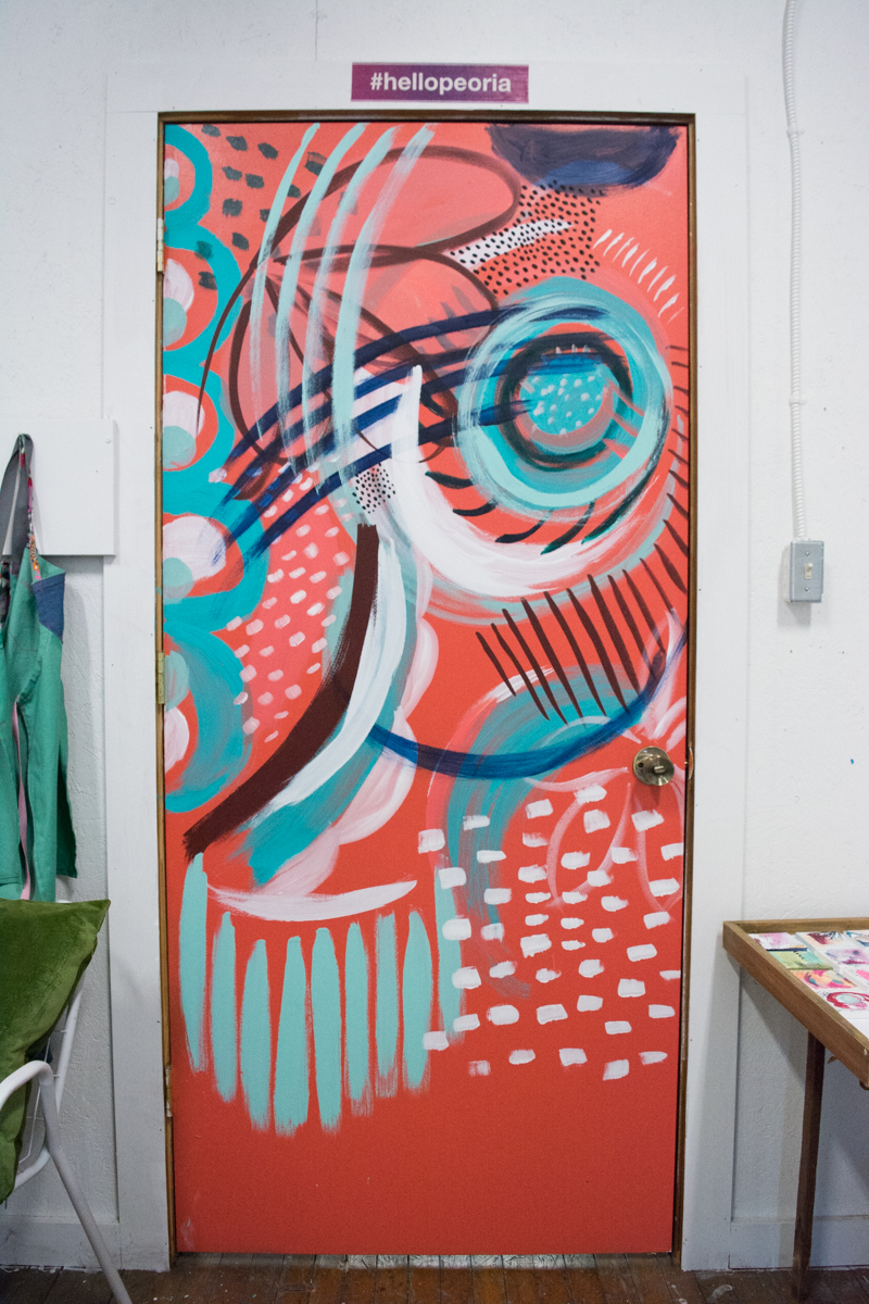 Her studio door is fantastic. Jaci painted it in the style of her paintings.
