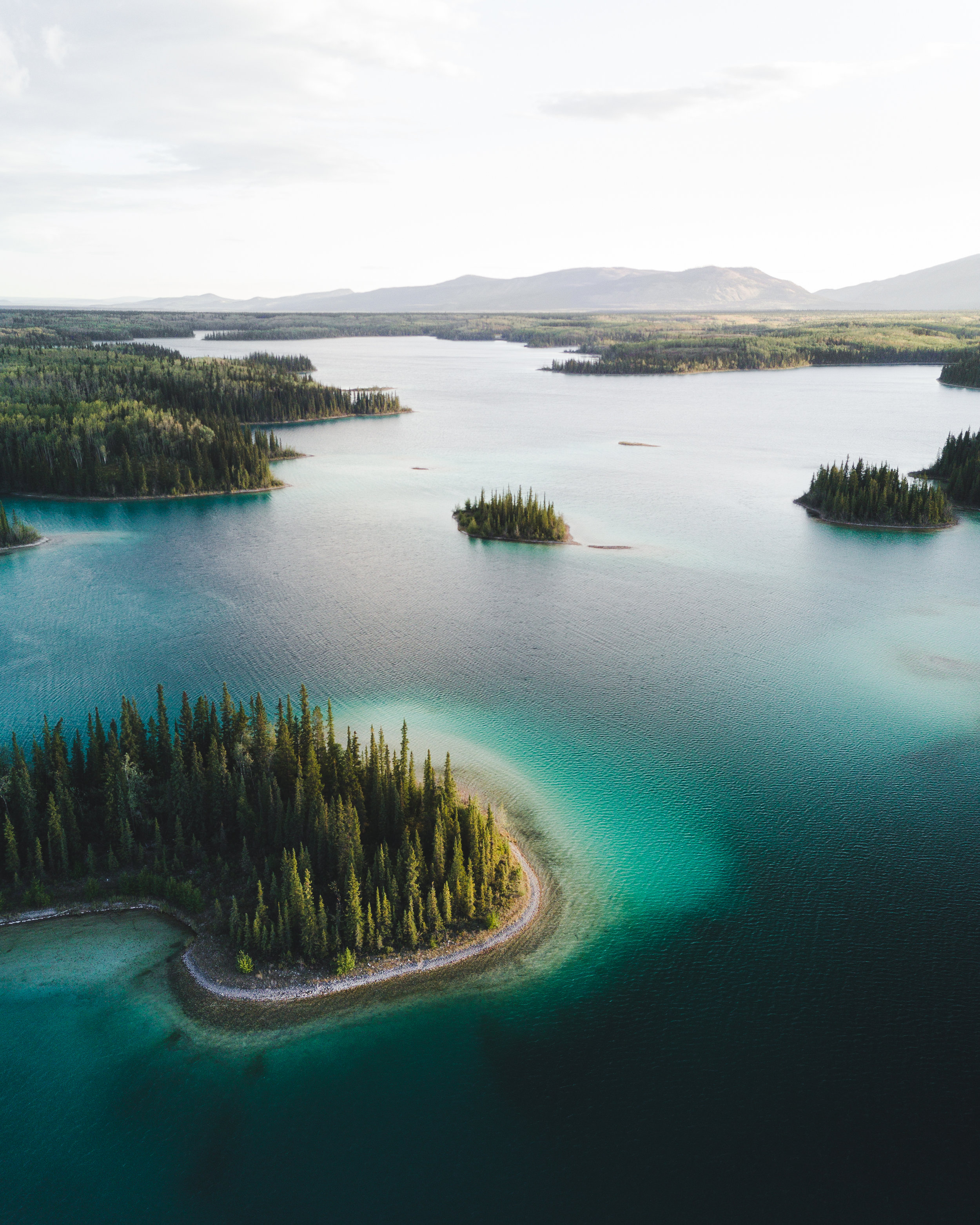 The crystal clear blue water of Boya Lake Provincial Park in Northern British Columbia looks more like the Caribbean than Canada.