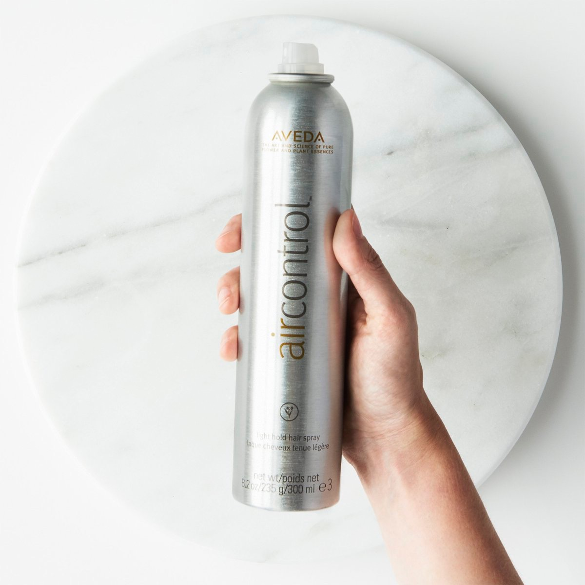 Air Control Hairspray - The final step in kicking the frizz all day is a fabulous finishing spray. Stylists love using Air Control to seal in frizz free hairstyles because this light hold spray is buildable to a firm hold without without creating any stickiness. And who doesn't love that signature Aveda aroma?