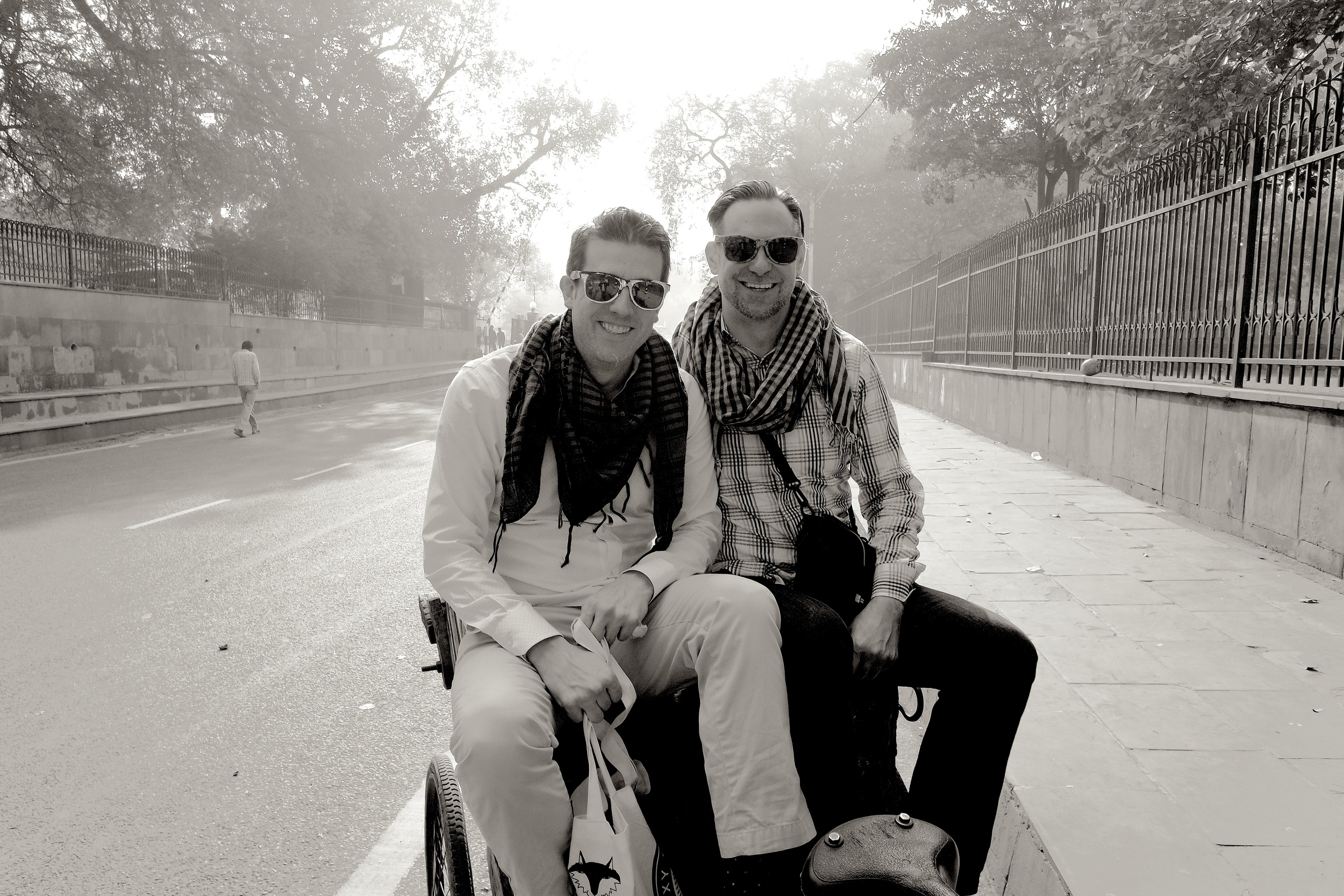 Wally and Duke precariously perched on the back of Mohammed's bicycle rickshaw, ready to explore Old Delhi