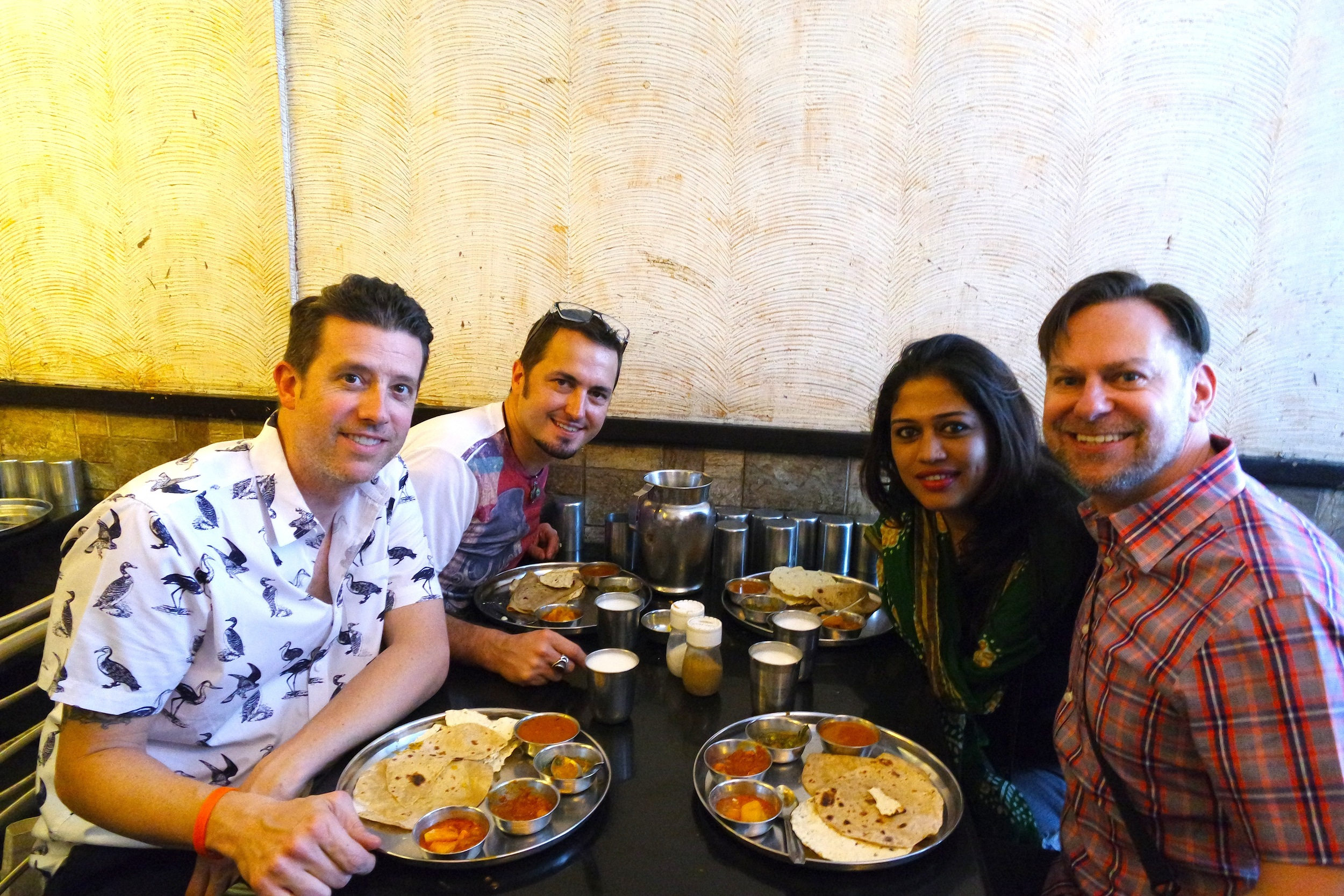 Wally, George, Manvi and Duke stuffing themselves silly on all-you-can-eat thali