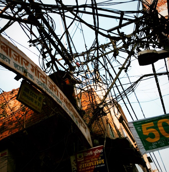 Wally snapped a quick pic as we wobbled along on the bicycle rickshaw through the narrow lanes of Old Delhi. Everywhere overhead were jumbles of wires like these