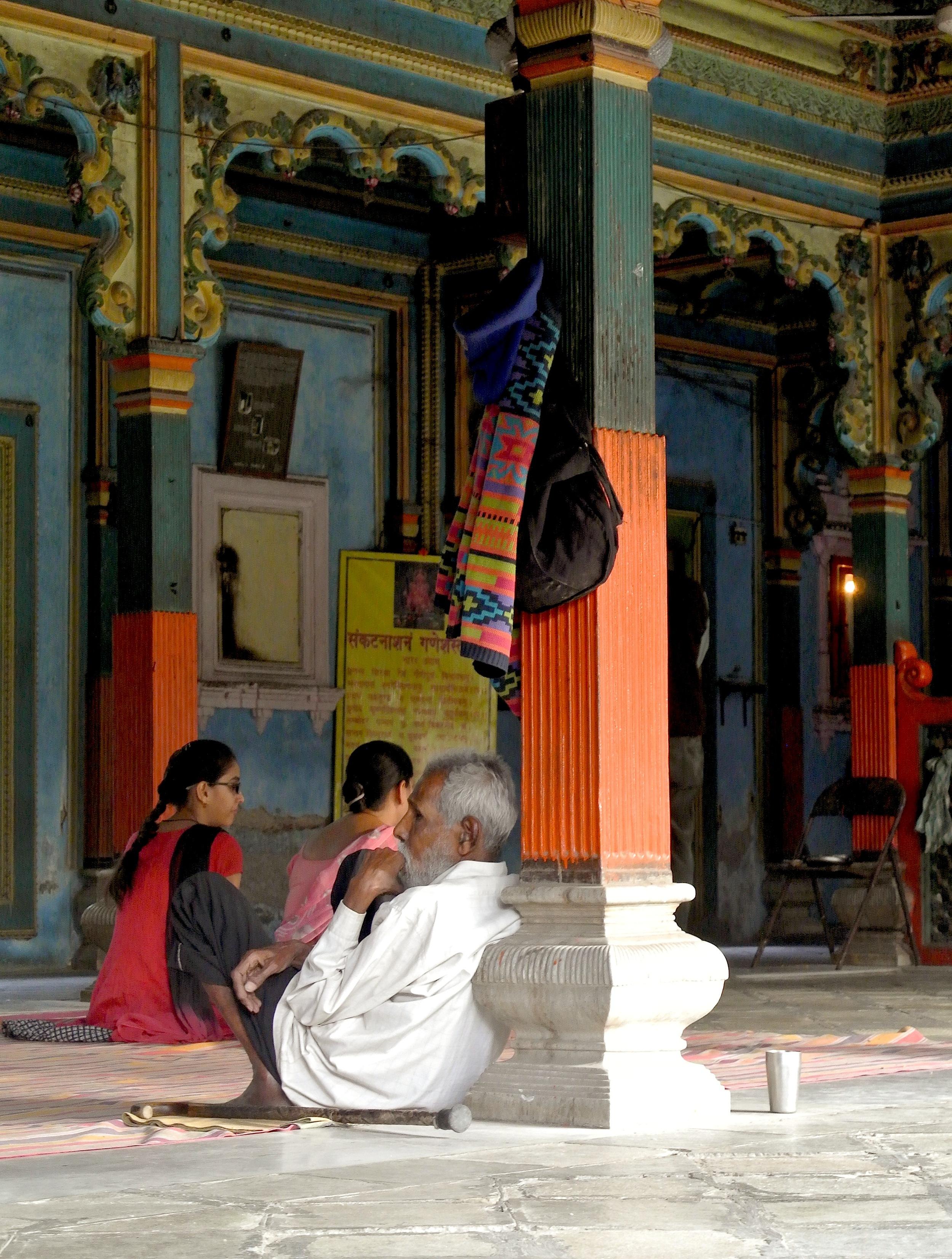 Worshippers inside a temple to Ganesha, the elephant-headed Hindu deity