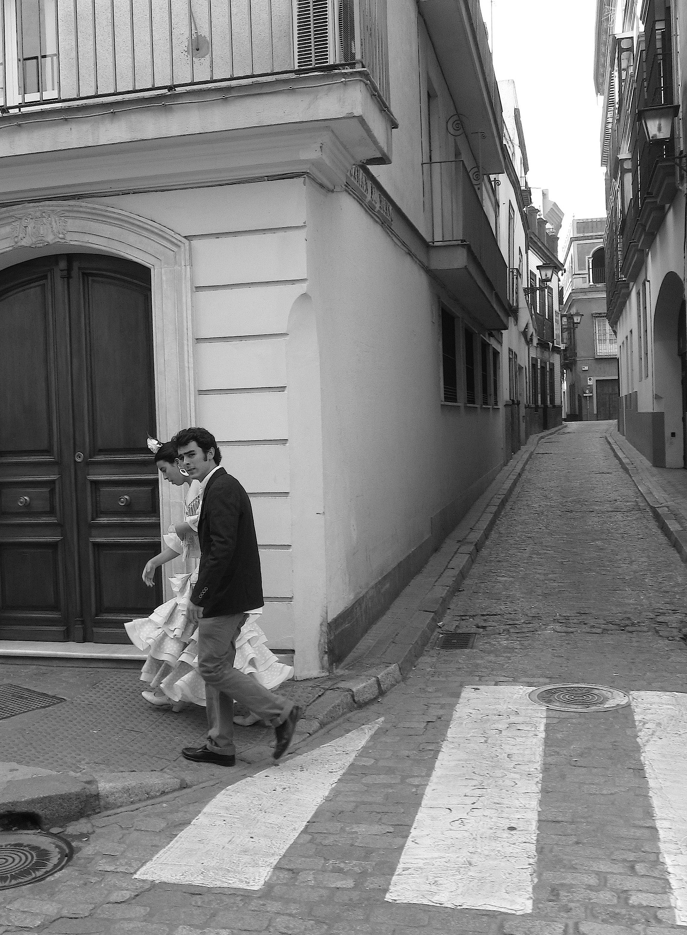 Women in flamenco dresses are common sights in Sevilla during Feria
