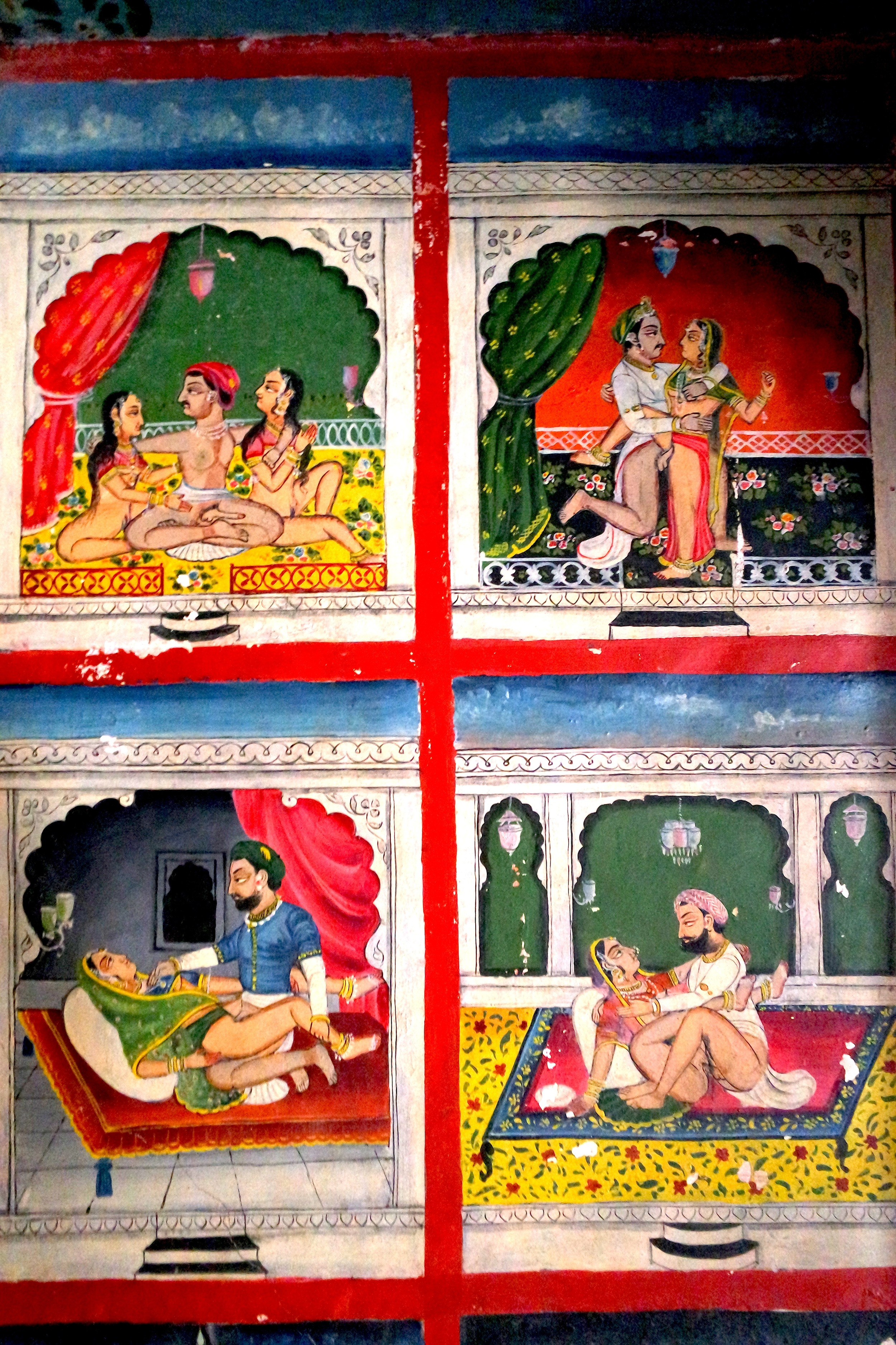 A cabinet on one of the top floors of the Juna Mahal depicts naughty scenes from the Kama Sutra