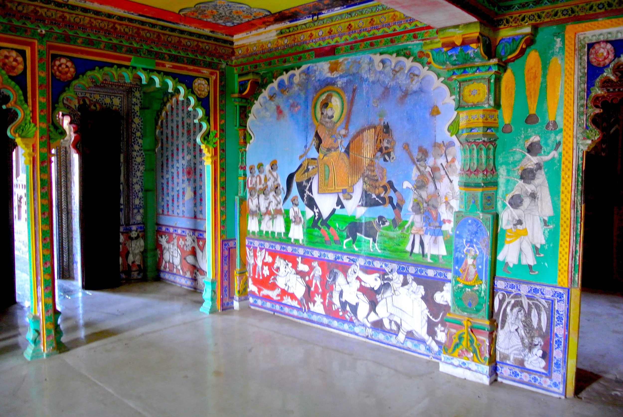 The brightly painted but fading walls of the Juna Mahal in Dungarpur, India