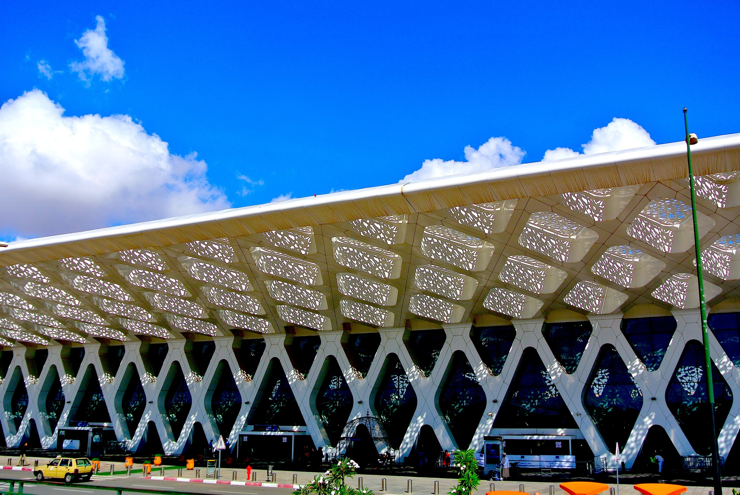 The modern façade of the Marrakech Menara Airport casts gorgeous lace-like shadows