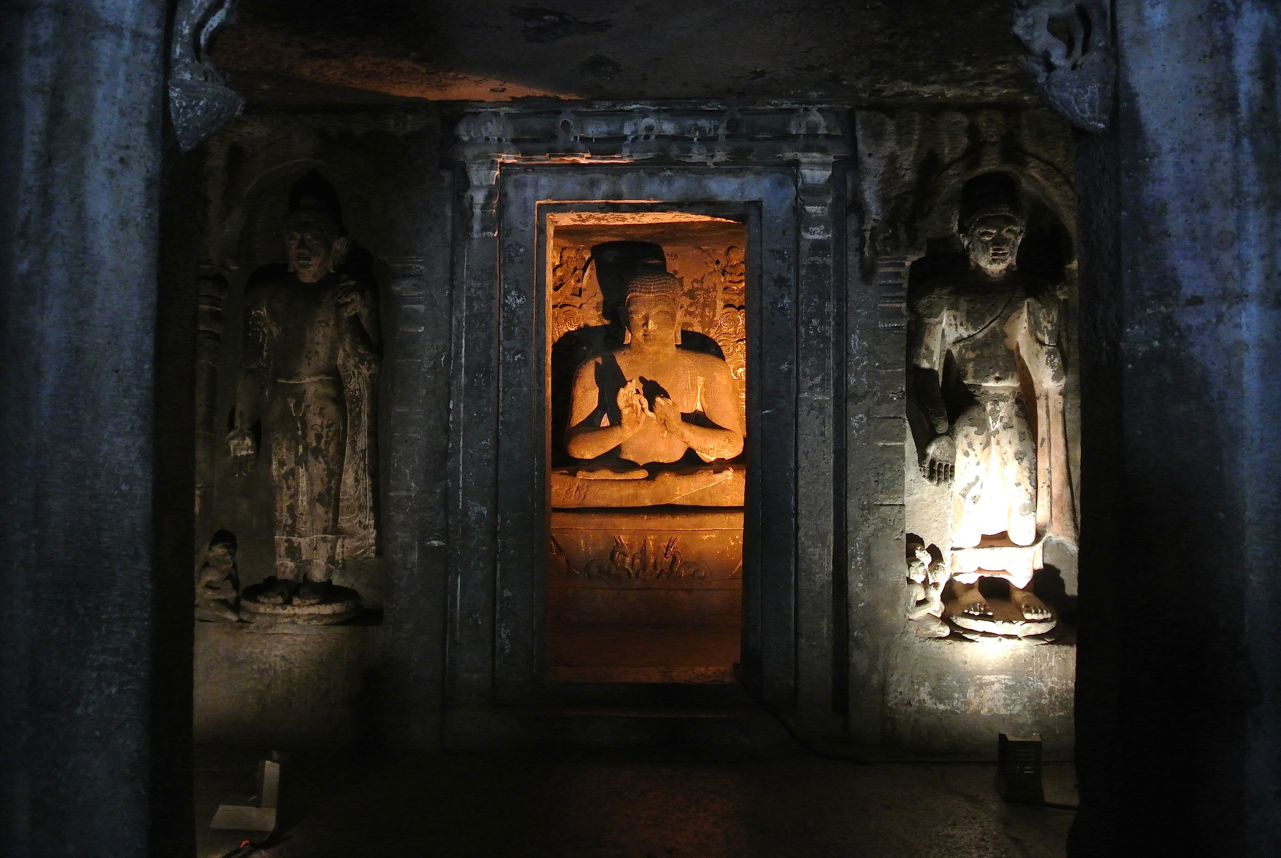 Cave 1: A statue of the Buddha flanked by Avalokitesvara and Vajrapani, the embodiments of compassion and spiritual energy