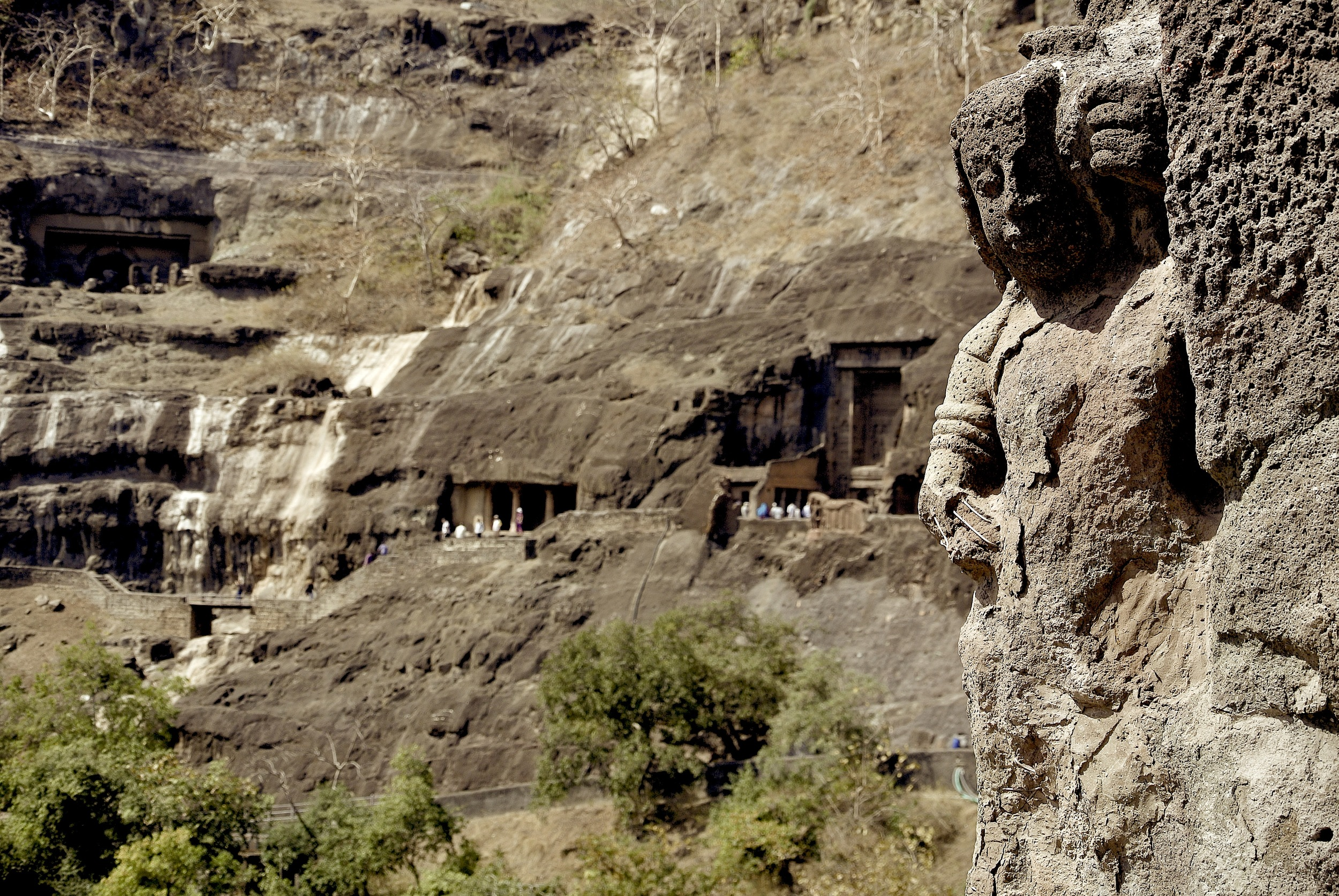 The Ajanta Caves look unassuming from the exterior — but within you'll find statues of the Buddha and fading frescos