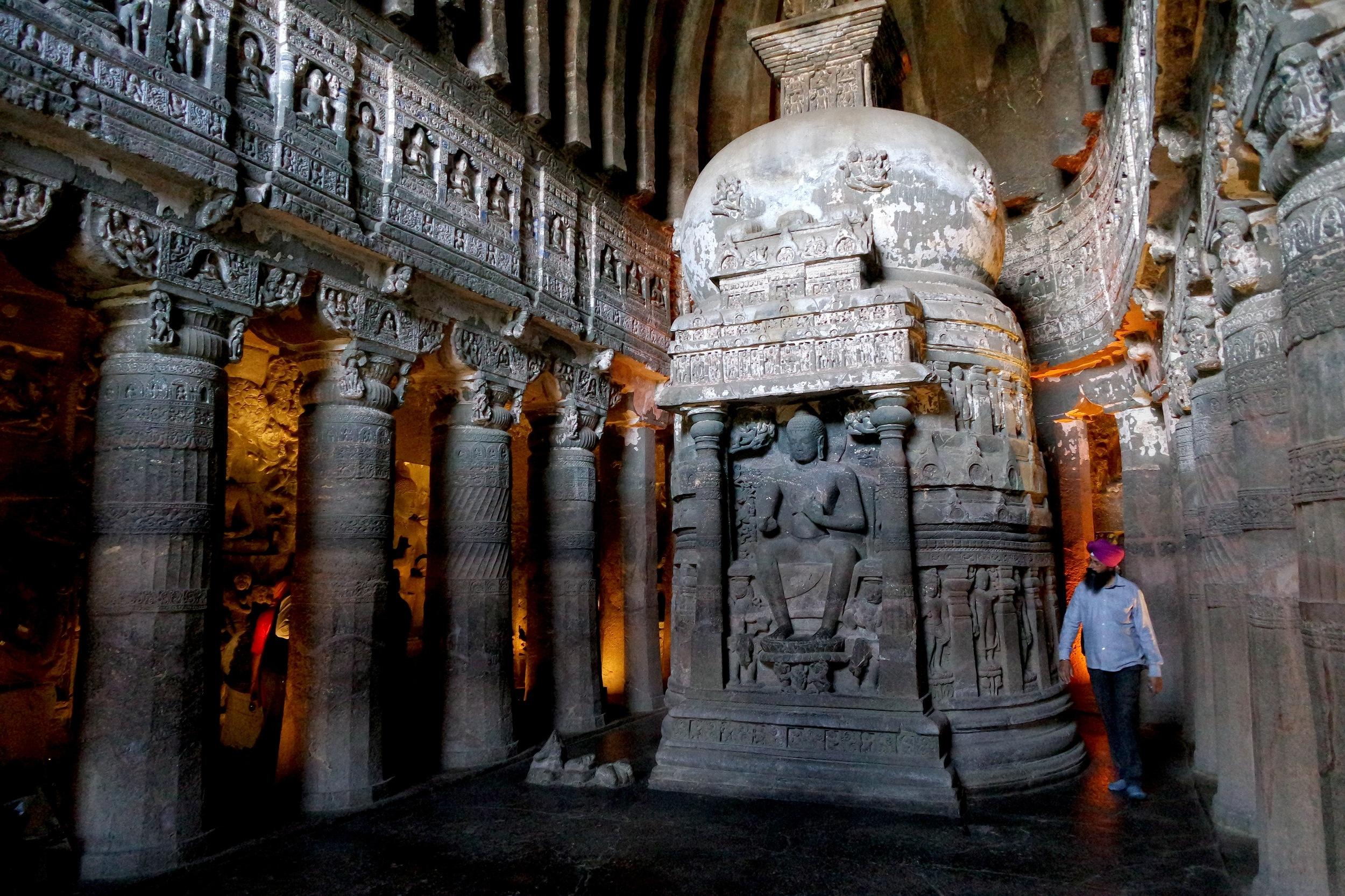 Cave 26: Devotees circumambulate, or walk around, the stupa