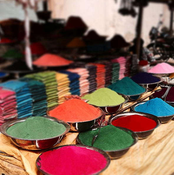 Piles of colored powder for sale at the Gulmandi Road Bazaar