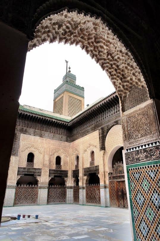 The medersa's minaret as seen through an interior archway
