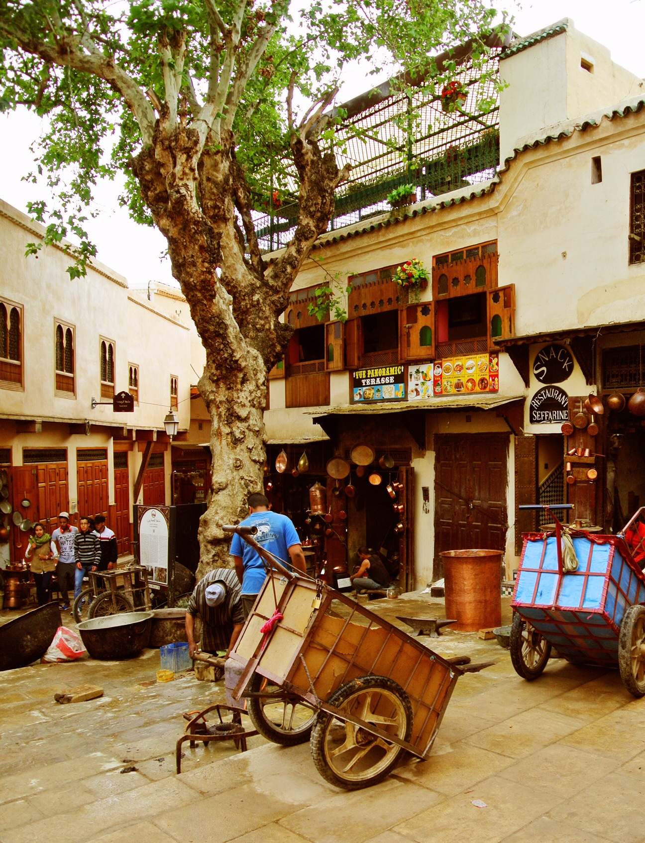 Place Seffarine, with its gnarled tree in its center, is one of the largest open public spaces in the medina