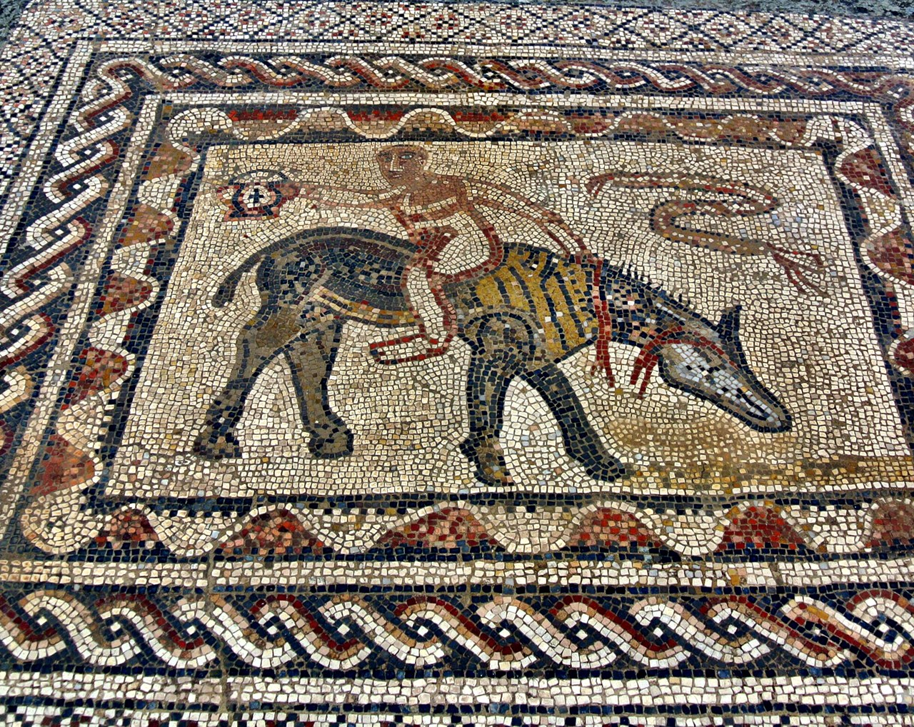 This mosaic of a guy who got on his horse backward is known as the acrobat