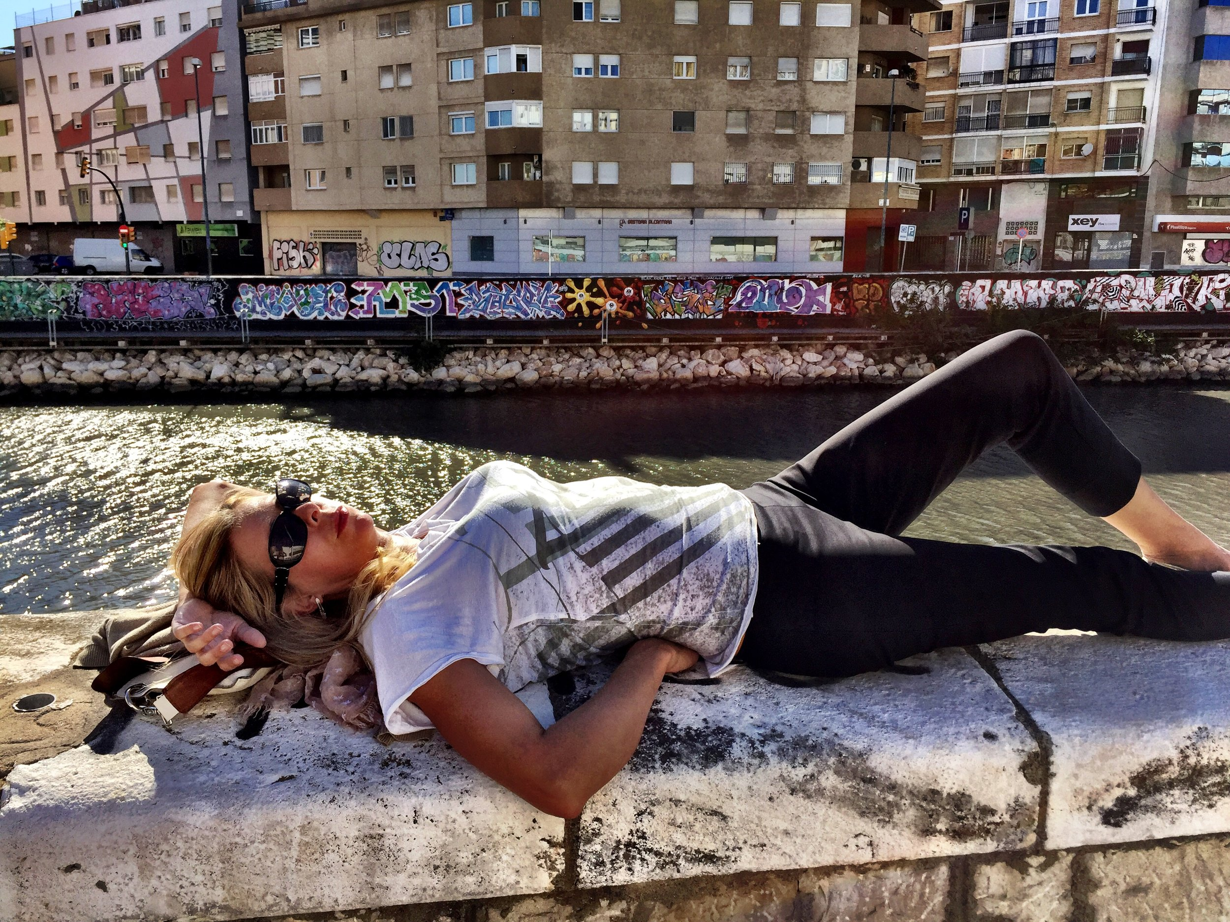 And if your street art hunt gets to be too much, just take a nap along the Guadalmedina River like Jo
