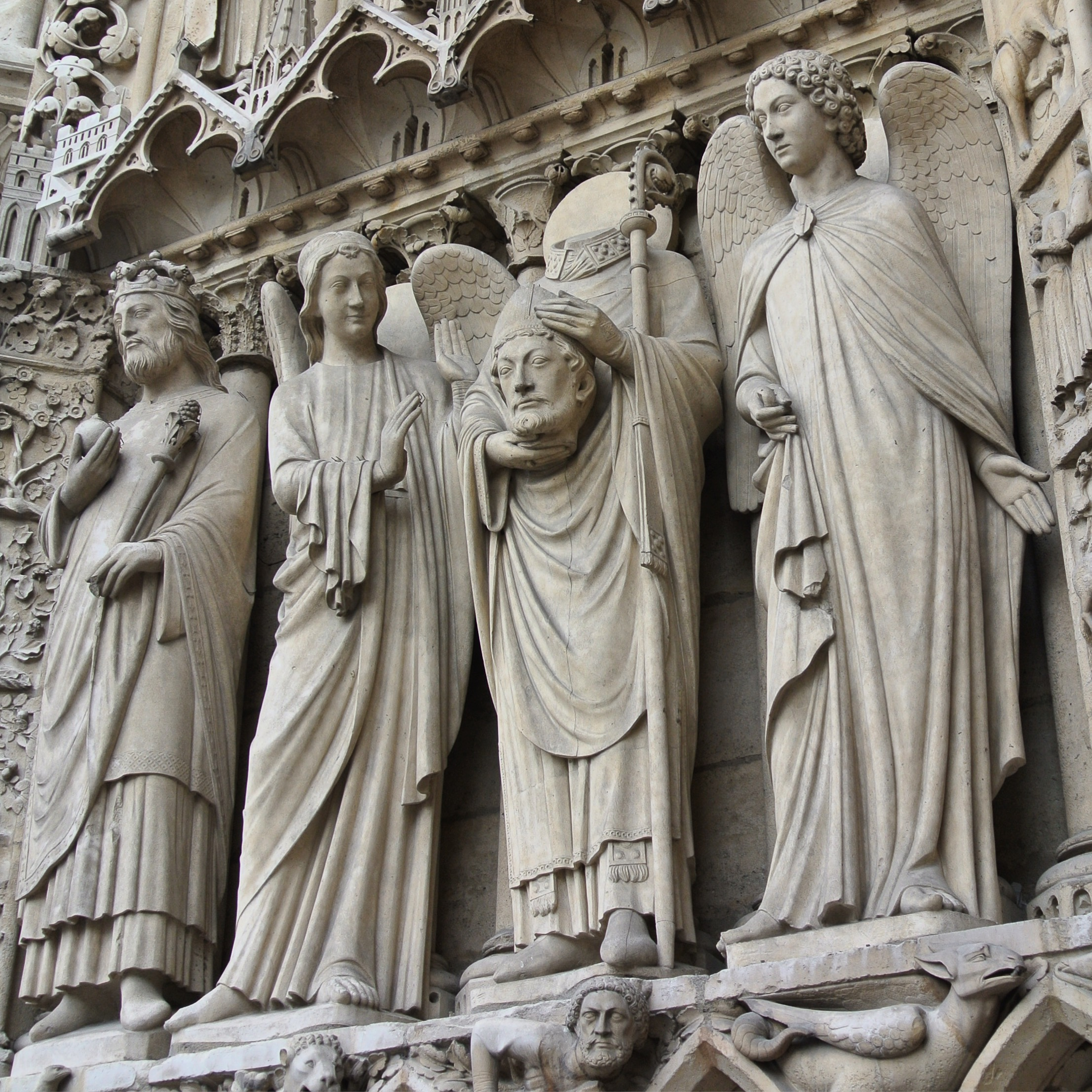 5.  The façade of Notre Dame in Paris has many interesting details, but perhaps none as unique as the sculpture in the left portal holding his head. The statue is of St. Denis, said to have picked his head up after being decapitated and walked six miles, while preaching a sermon of repentance the entire way. If it takes me 45 minutes on the treadmill at 6 miles per hour, he would have walked an hour plus!