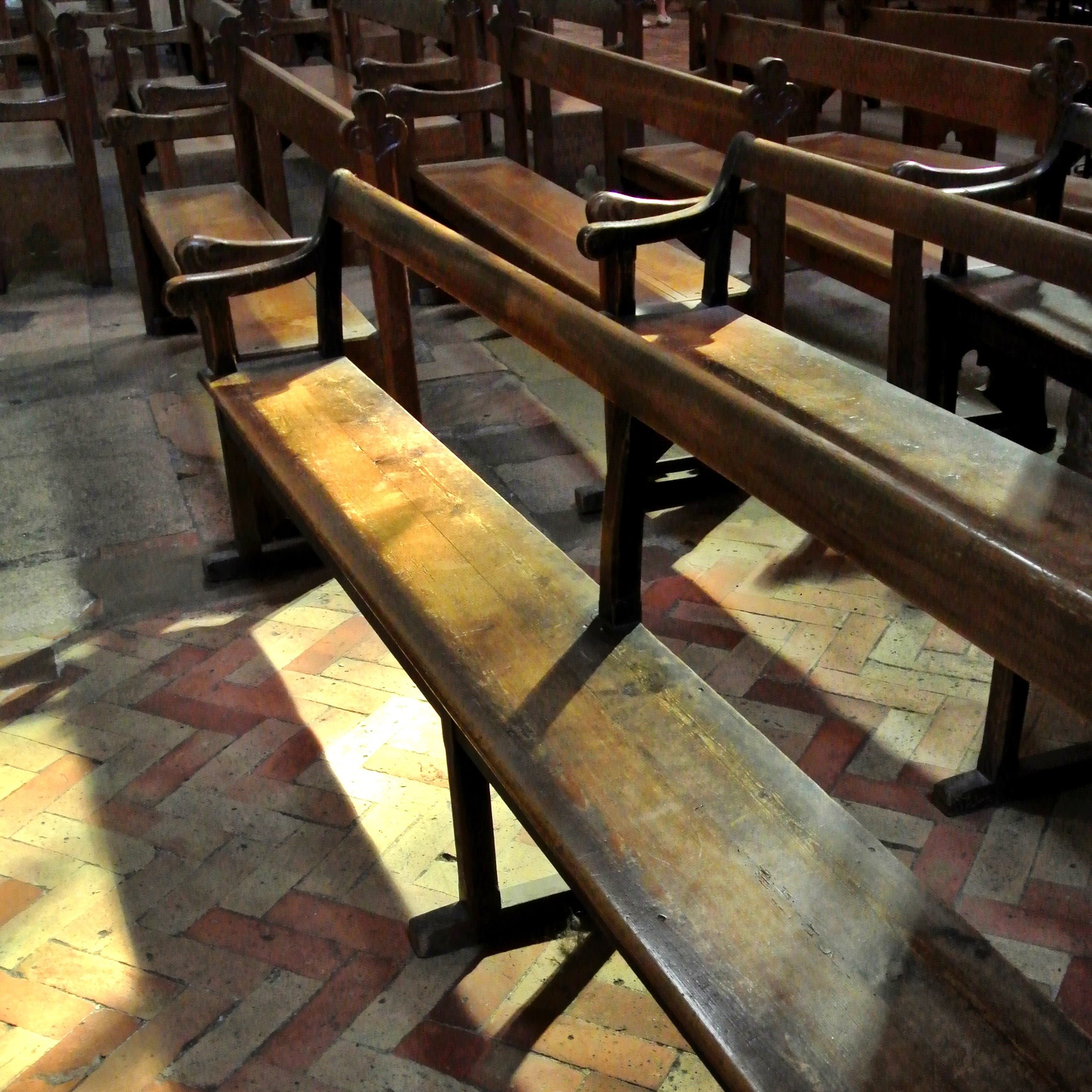 16.  Benched. There is something beautiful in the patina of these benches in Aix Cathedral combined with the well-worn brick floor that has stood the test of time.