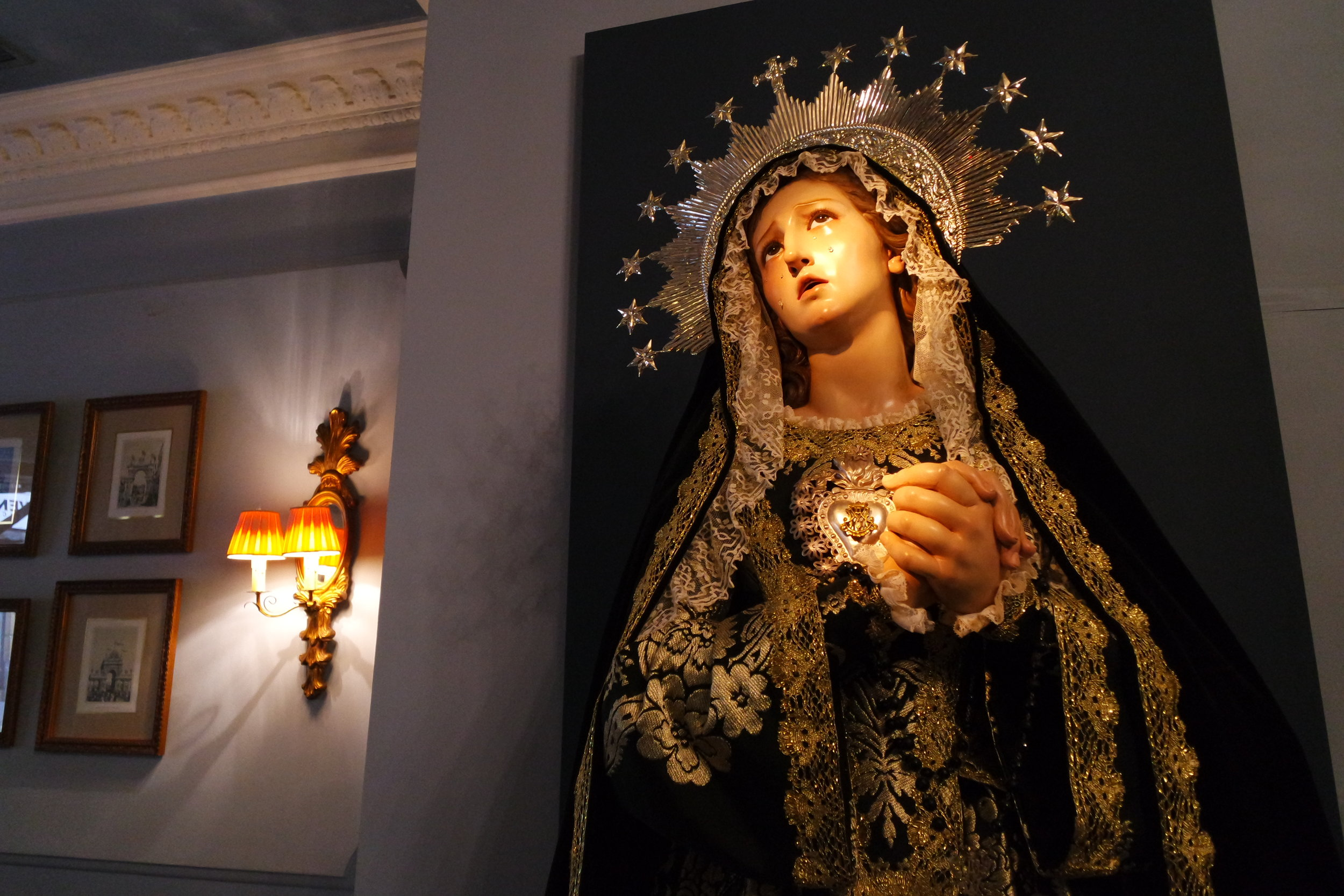 La Dolorosa  ( Our Lady of the Sorrows).  Resin teardrops, glass eyes and actual clothes add to the realism of the pained expression of the Virgin Mary, featured at Puerta Oscura in Málaga