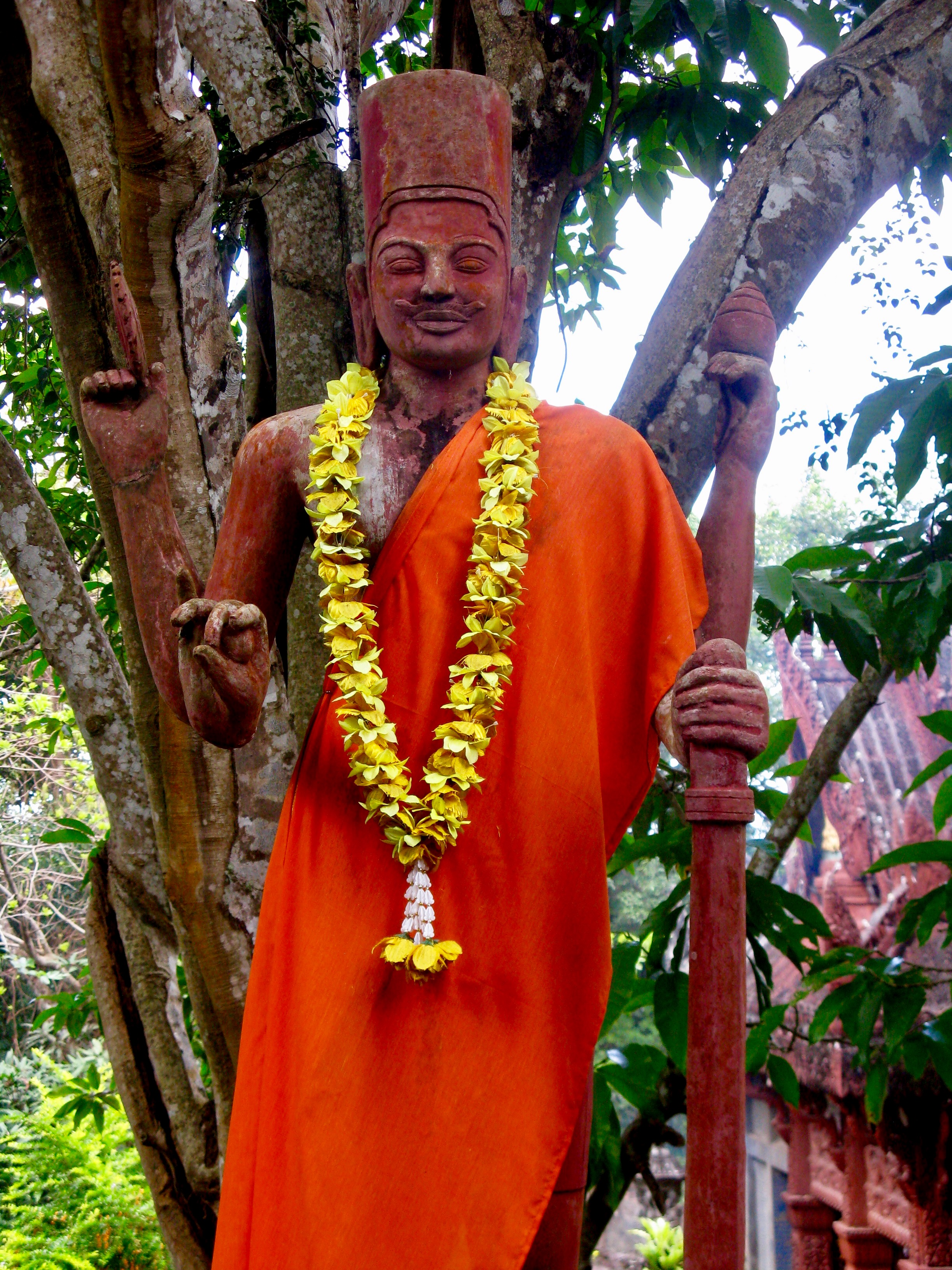A statue of Vishnu draped in saffron cloth