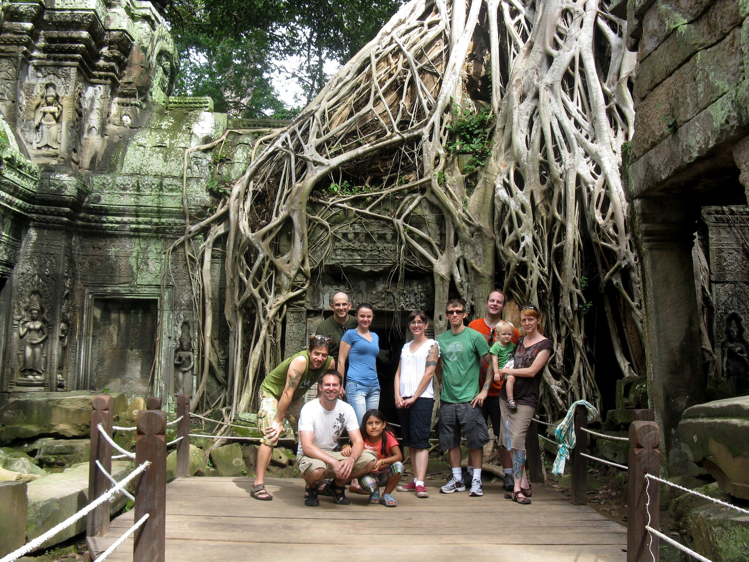 An obligatory photo of our group taken underneath the roots of the towering strangler fig tree in the inner courtyard at Ta Phrom, where Angelina Jolie's Lara Croft picked a jasmine flower before falling into the catacombs of the temple