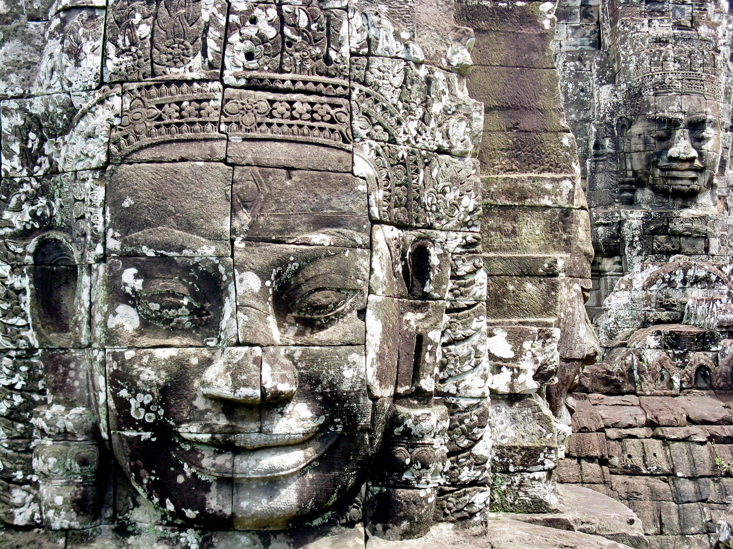 The smiling heads that are found throughout the Bayon Temple complex most likely depict the king — not the Buddha as many assume
