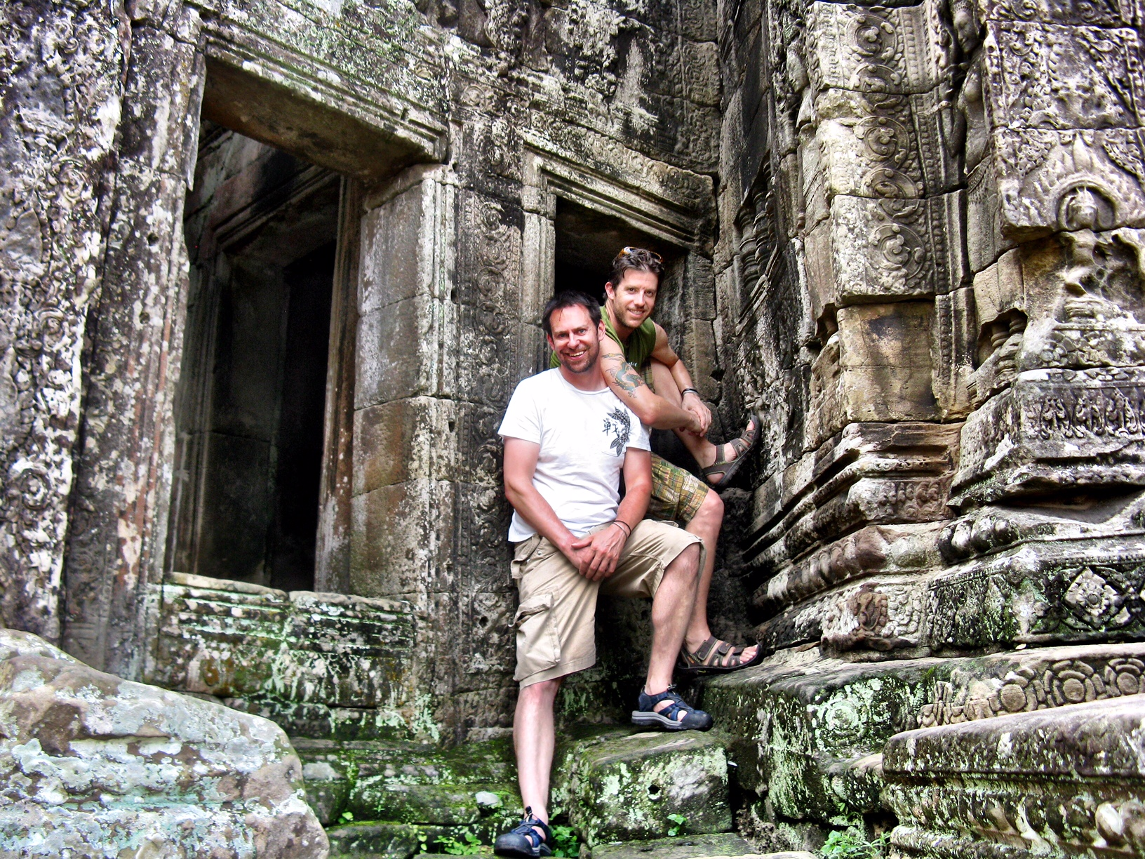 Duke and Wally were giddy kicking off their exploration of Angkor wandering Bayon, with its intricately carved bas reliefs and giant stone faces