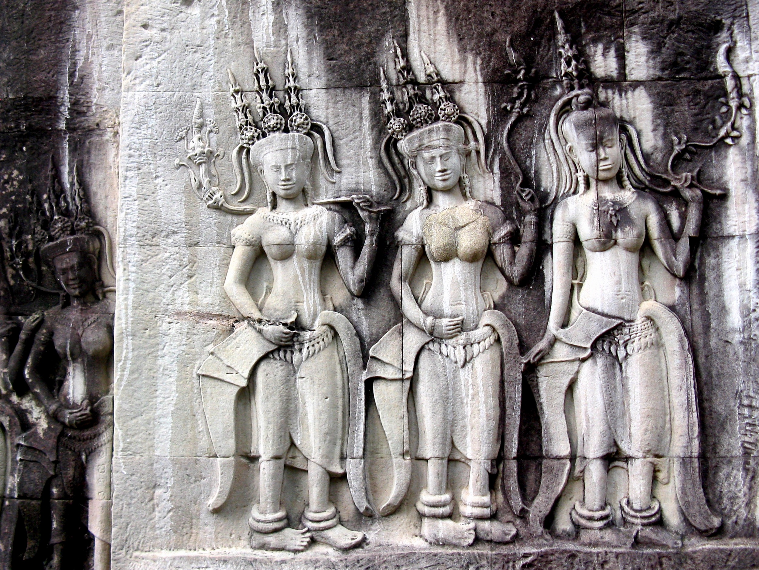 Three of the 3,000 depictions of buxom celestial spirits known as apsaras