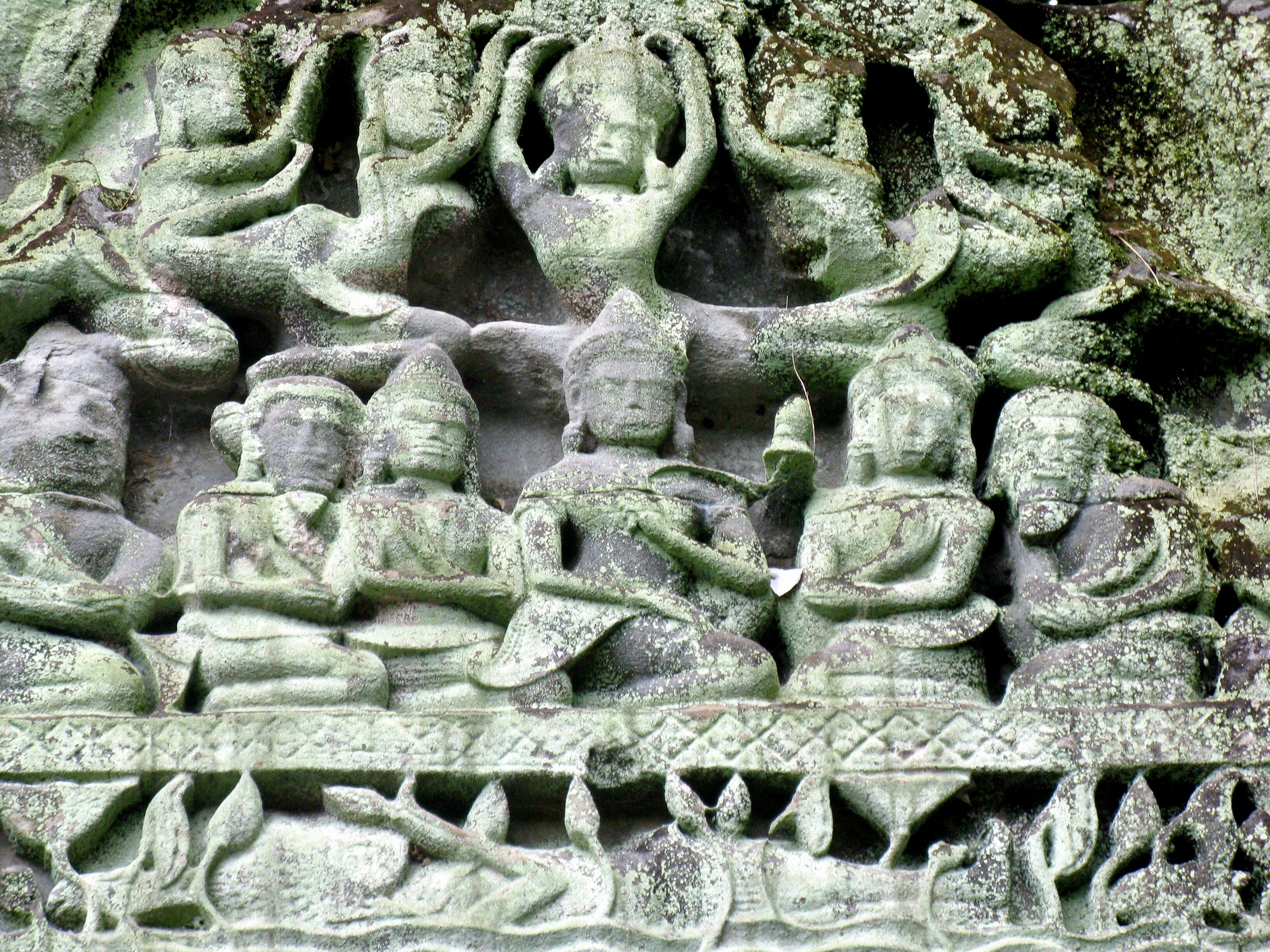 Lichen-covered carvings at Beng Mealea, where nature has reasserted itself
