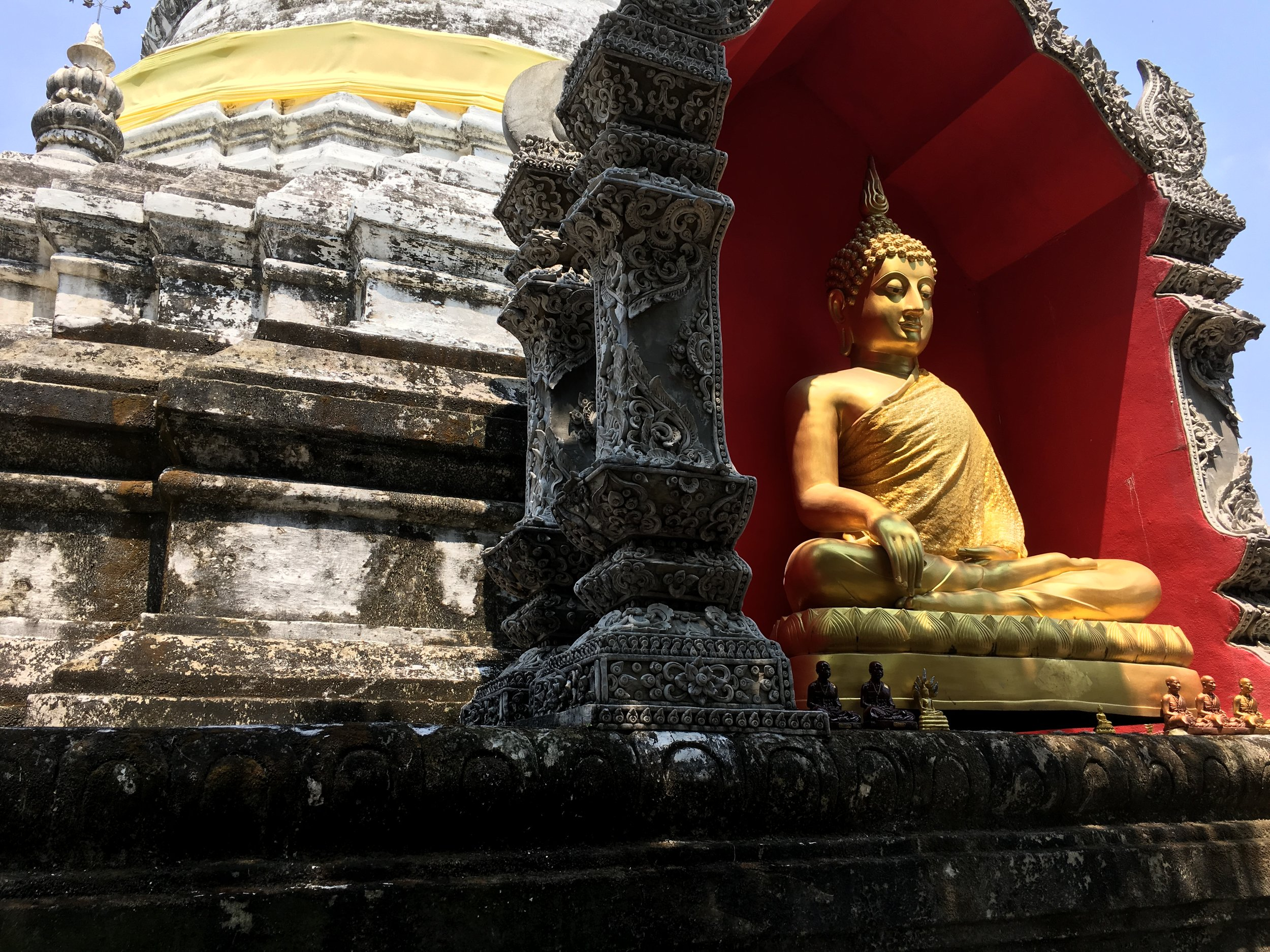 This Buddha in a red niche is one of four at the base of the tower that is said to hold a sacred relic