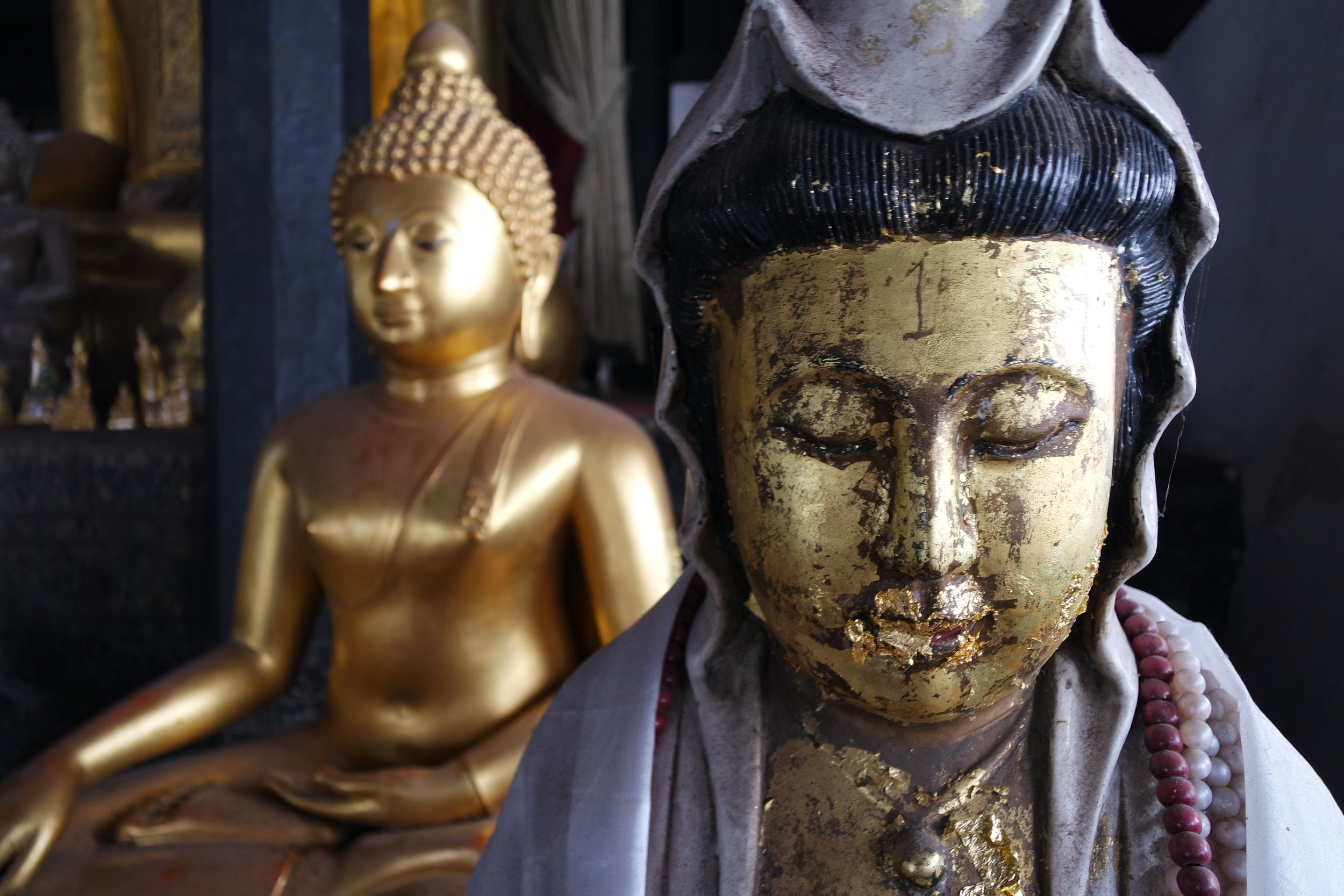 Buddhist temples are filled with various statues in all sorts of mismatched styles