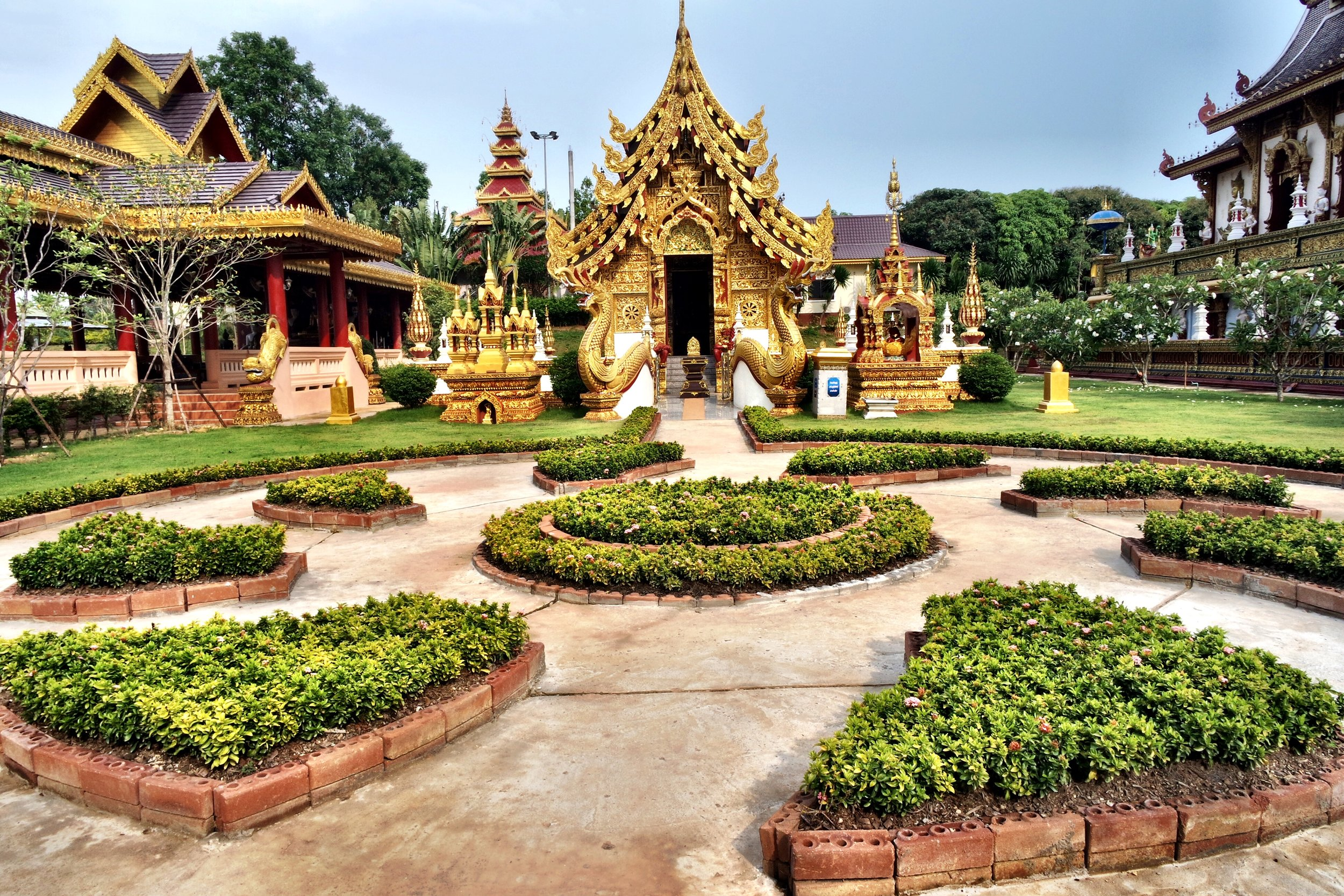 The front area of Wat Sang Kaew is gorgeously landscaped