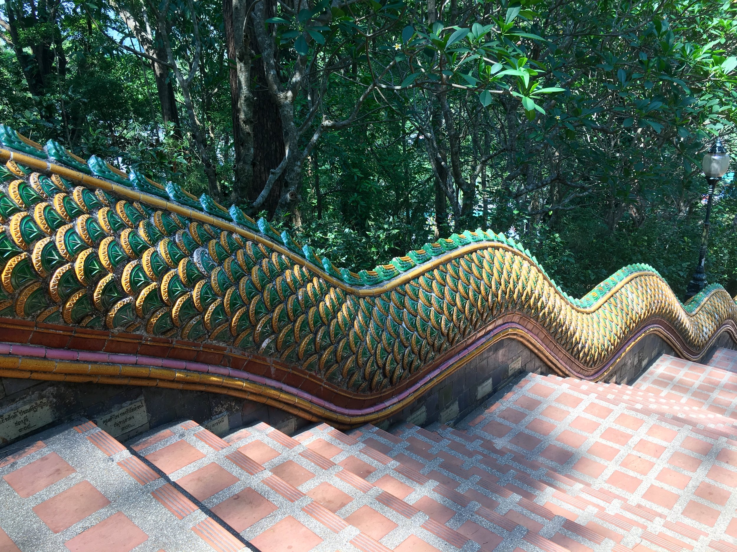 The lengthy staircase at Doi Suthep has railings that slither upwards in the shape of snakelike nagas