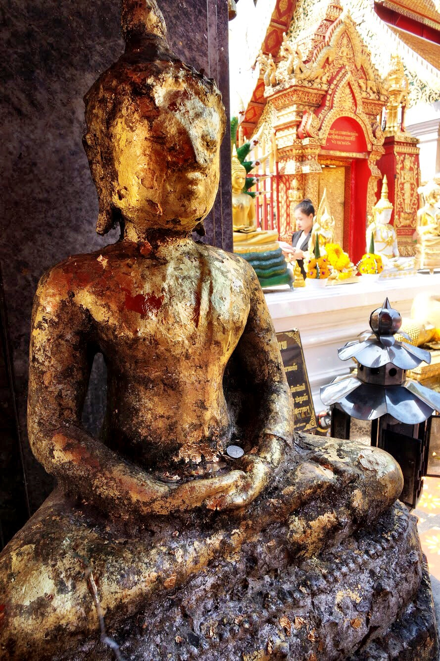 This image of the Buddha at Wat Doi Supthep is covered in gold leaf