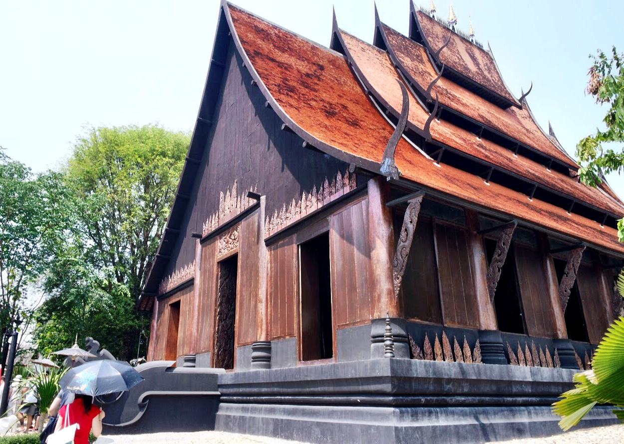The dark, weathered exterior of Baan Dam's Main Sanctuary Hall appears a bit sinister